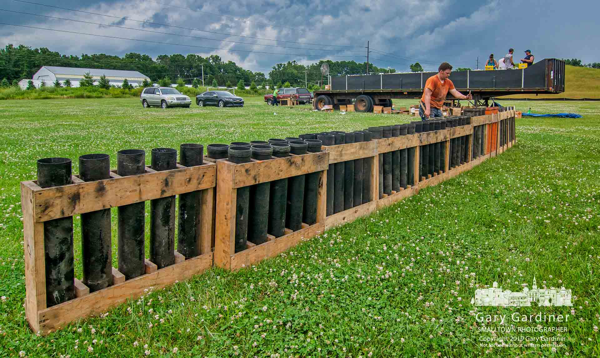 The fireworks crew moves mortar tubes into position as it prepares more than 1,200 projectiles to be fired at the Kuly4th firewqorks show in Westerville. My Final Photo for July 3, 2019.