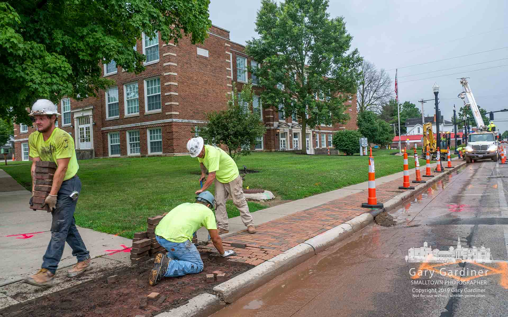 Workers for two contractors begin construction on the Uptown Streetscape Improvement project by removing bricks from the sidewalk, cutting away about a foot of asphalt roadway, and removing streetlights in front of Hanby Elementary before rebuilding the sidewalks and expanding them about a foot into State Street before school starts August 13. My Final Photo for July 22, 2019.