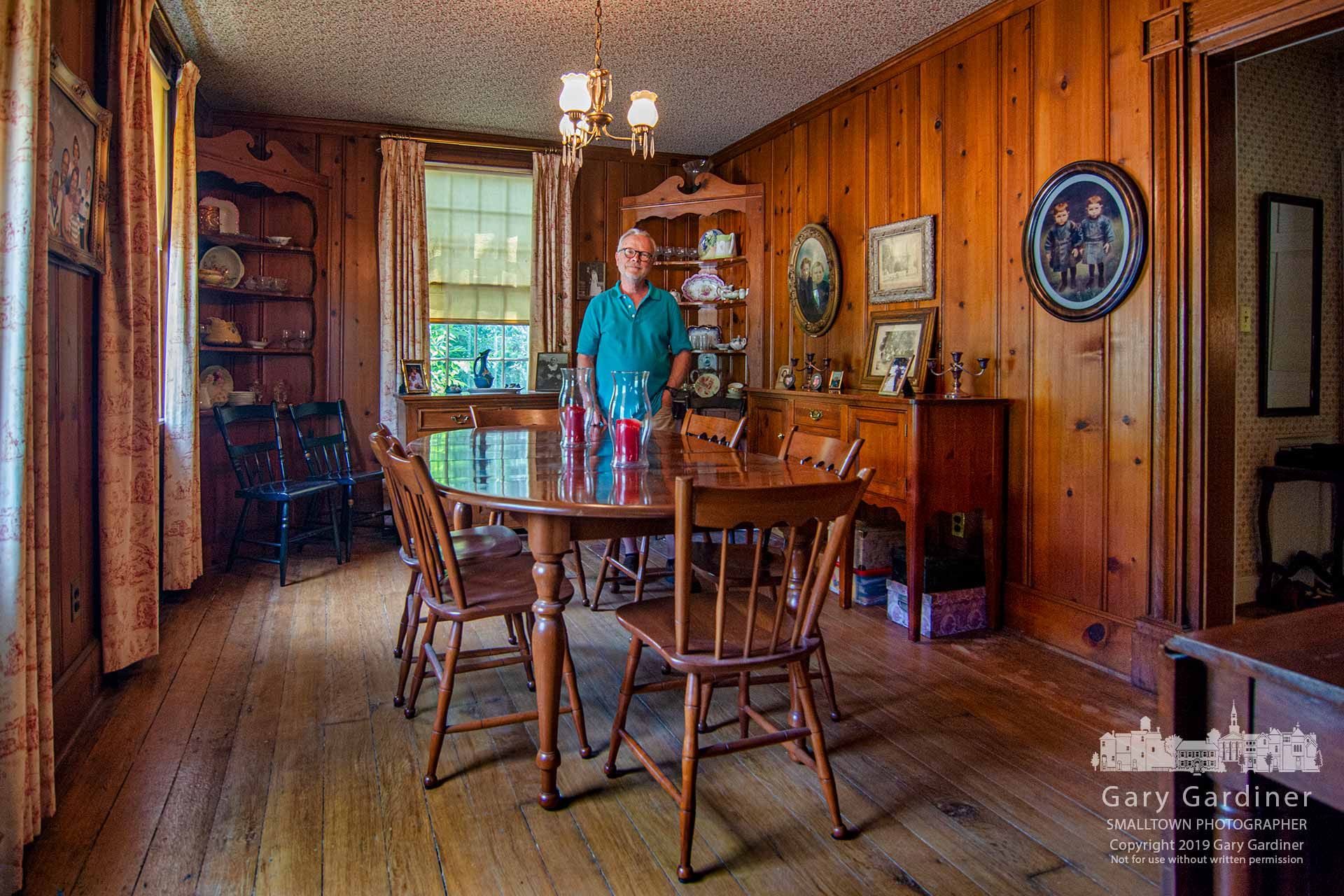 Bill Goldsmith stands in the dining room of the Ebenezer Washburn historical home on South Sunbury Road during the Tapestry of a Town annual tour of homes and businesses in Westerville that bear a portion of the region's heritage. My Final Photo for July 28, 2019.