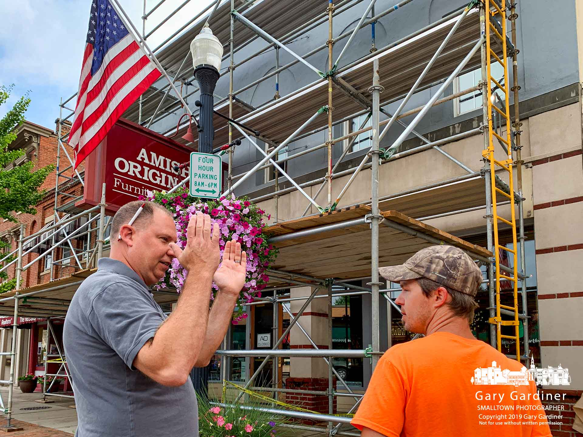 Mike Deringer, left, of Amish Originals in Uptown Westerville talks with his contractor about paint trim colors and locations as the business upgrades its facade with a change of colors. My Final Photo for Aug.13, 2019.