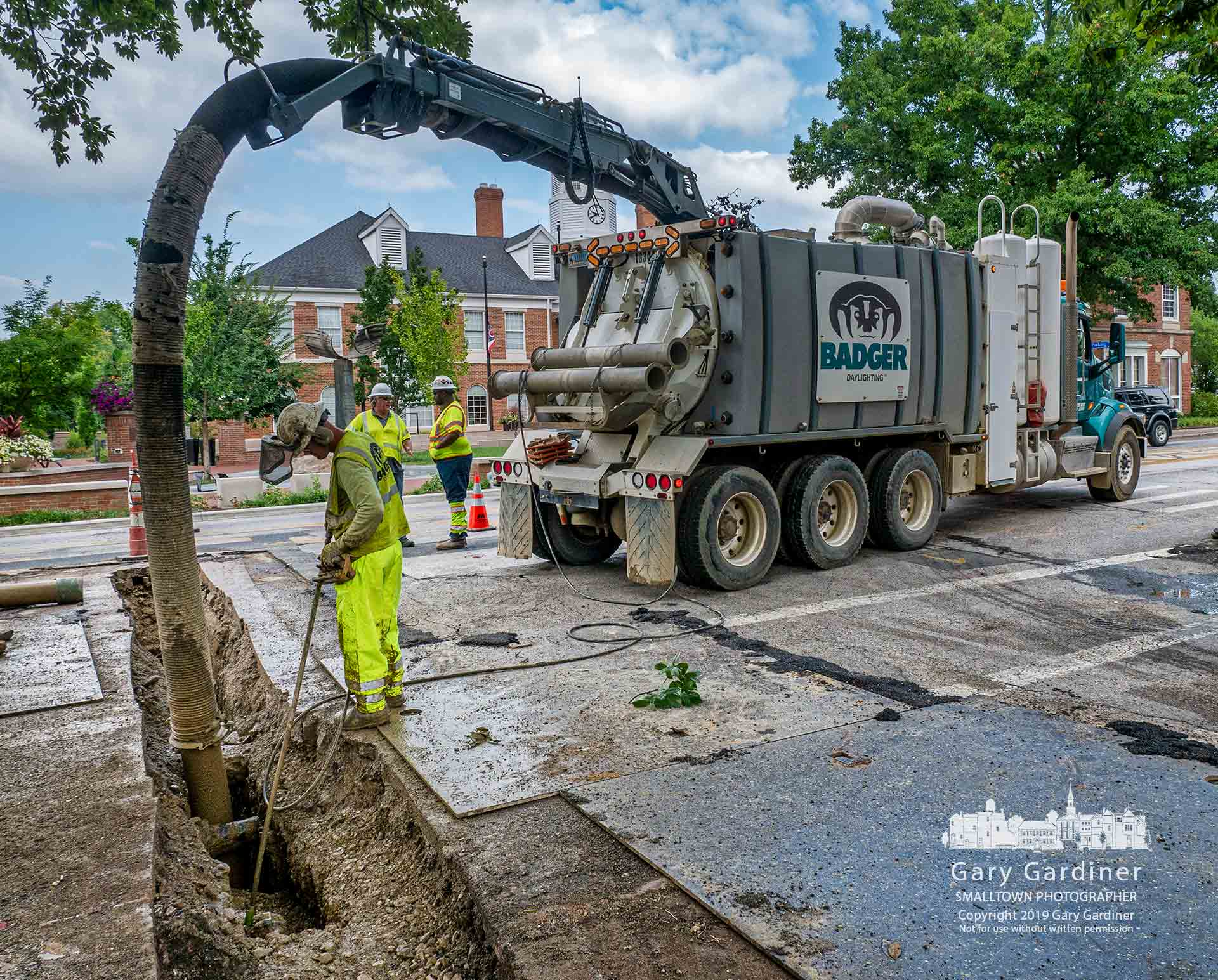 A work crew for Columbia Gas vacuum clears a trench from Winter Street into State Street as the company continues its operations to install higher pressure underground pipeline in Uptown Westerville. My Final Photo for Aug. 7, 2019.