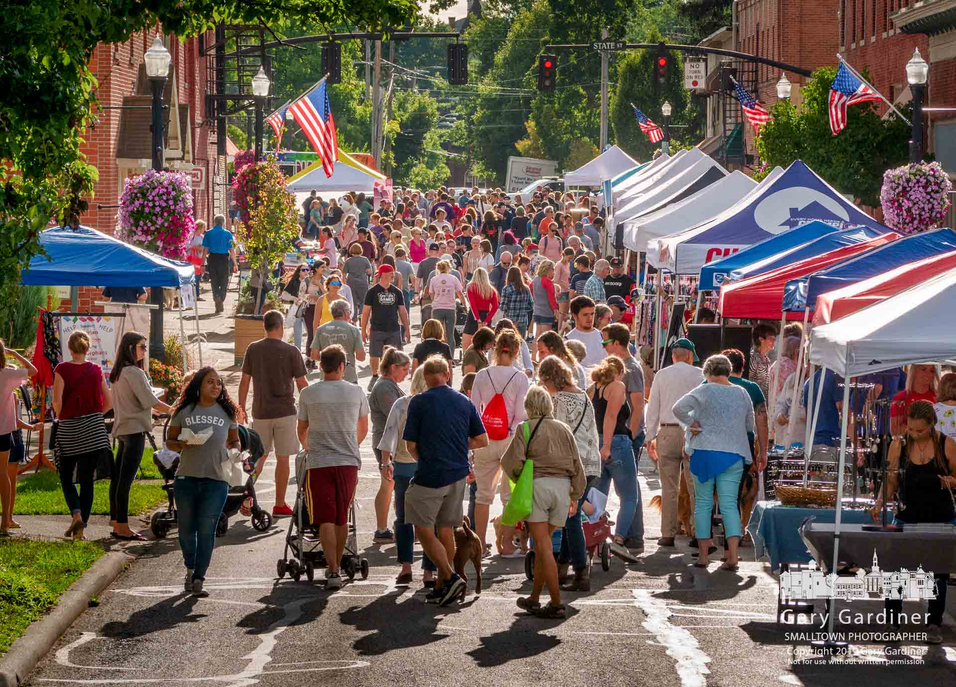 The Fourth Friday crowd works its way along East College past vendors and shops open on a cool and sunny day in late August. My Final Photo for Aug.23, 2019.
