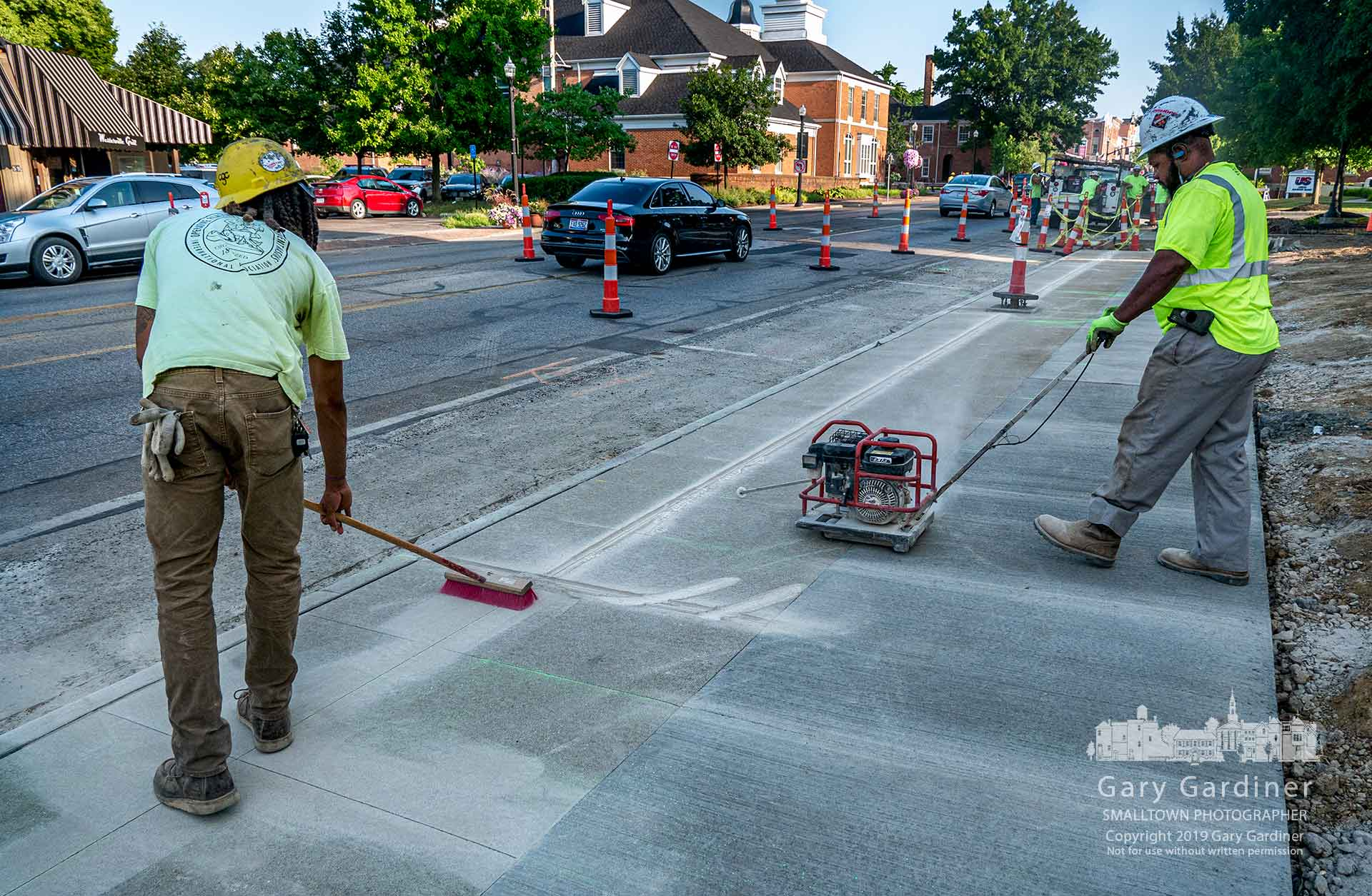 Workers cut joints into the sidewalks in front of Hanby Elementary where two styles of surface preparation are the first to be seen for the upgrades to sidewalks in Uptown Westerville. My Final Photo for Aug. 5, 2019.