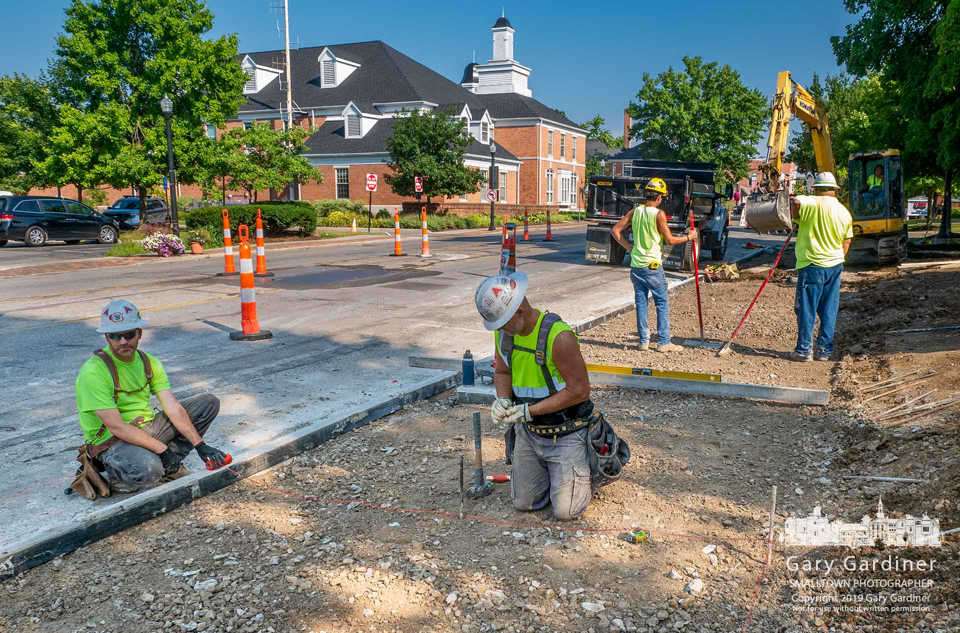 Workers remeasure elevations for the second pouring of the sidewalk in front of Hanby Elementary after the first pouring failed to meet ADA specification for the proper slope and had to be torn out. My Final Photo for Aug. 6, 2019.