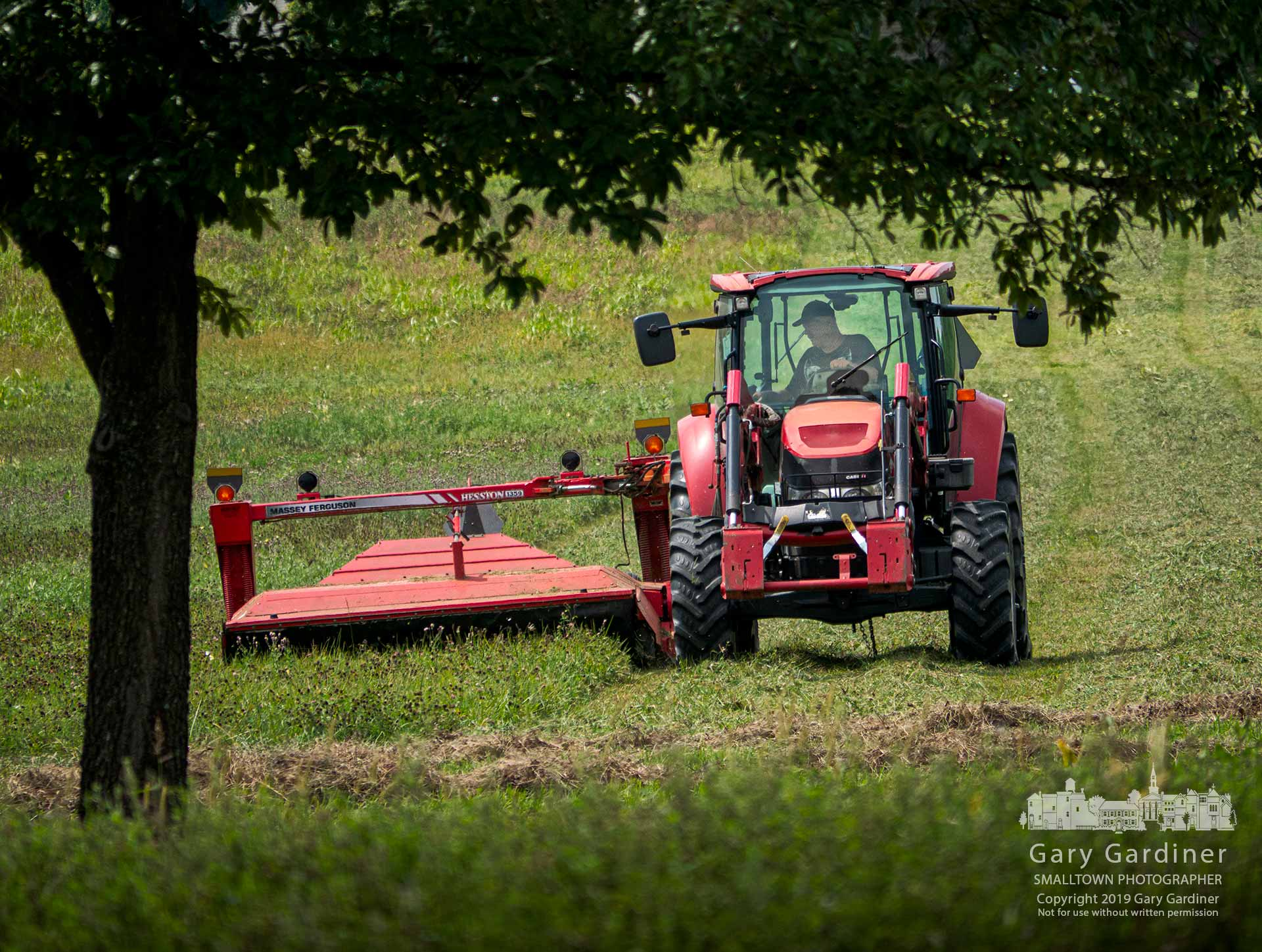 Kevin Scott cuts a section of the Otterbein hayfield along Collegeview before beginning to bale a section he cut earlier in the week. My Final Photo for Aug. 30, 2019.