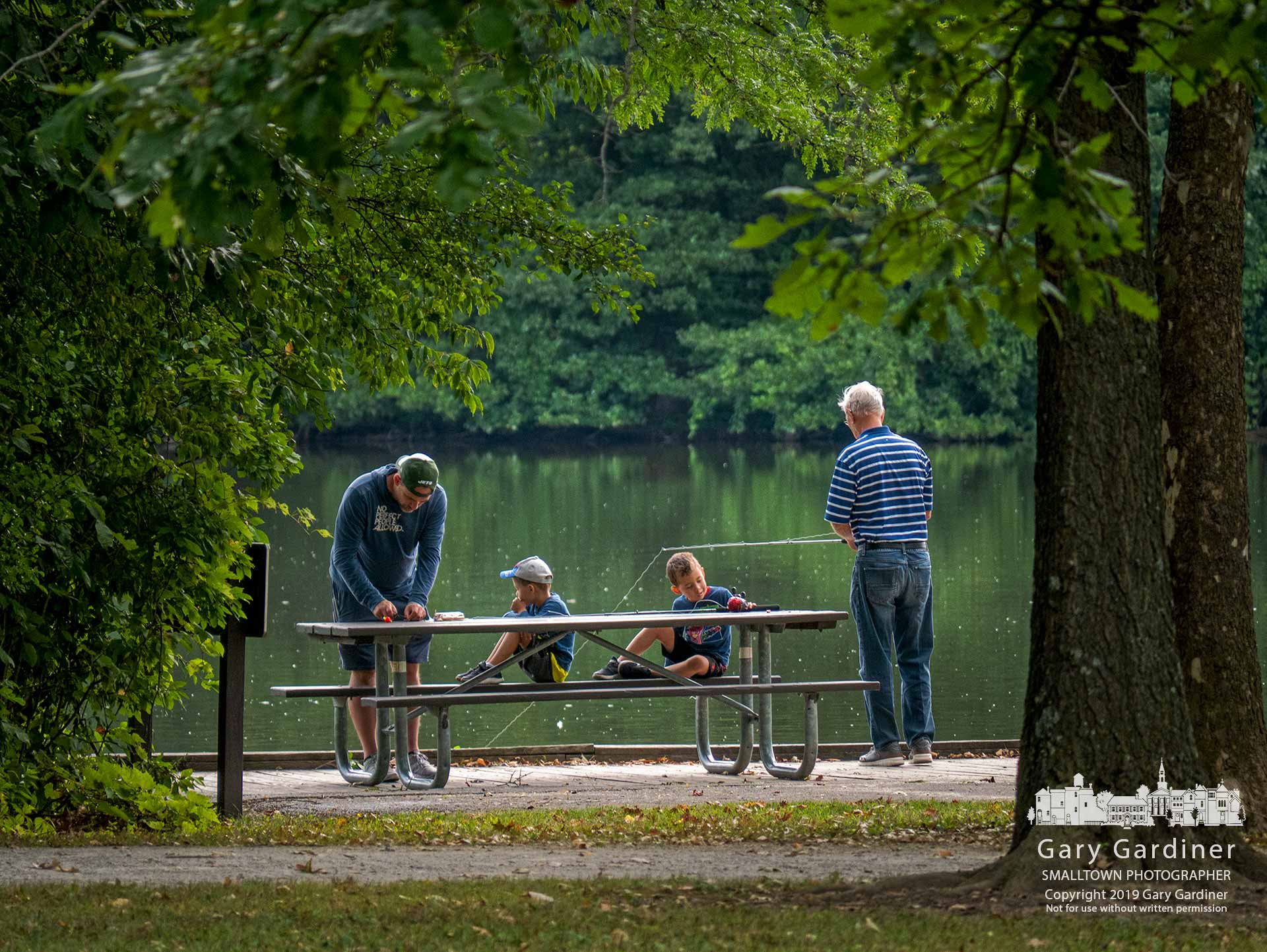 A grandfather, father, and two sons settle in for a morning of fishing at the pond in Sharon Woods Metro Park. My Final Photo for Aug. 10, 2019.