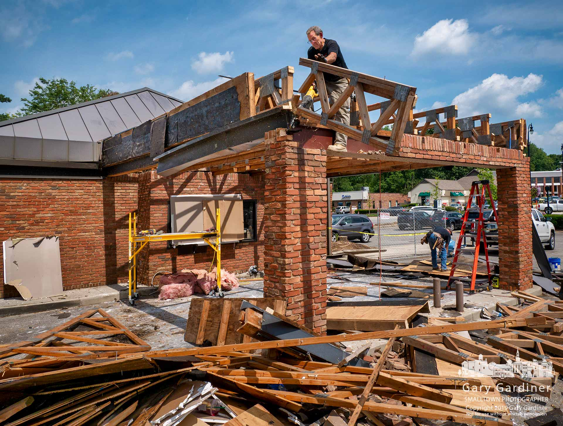 A two-man demolition crew removes the drive-thru overhang at the Starbucks on South State as the coffee purveyor builds a new entrance, drive-thru, and parking lot. My Final Photo for Aug. 20, 2019.