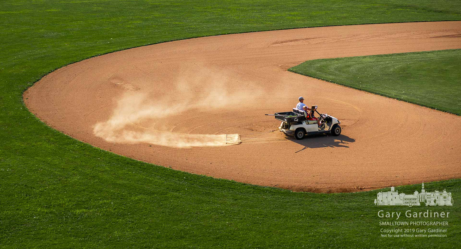 Two young boys get a ride-along as the Westerville North groundskeeper drags the infield prepping it for the next game. My Final Photo for Aug. 2, 2019.