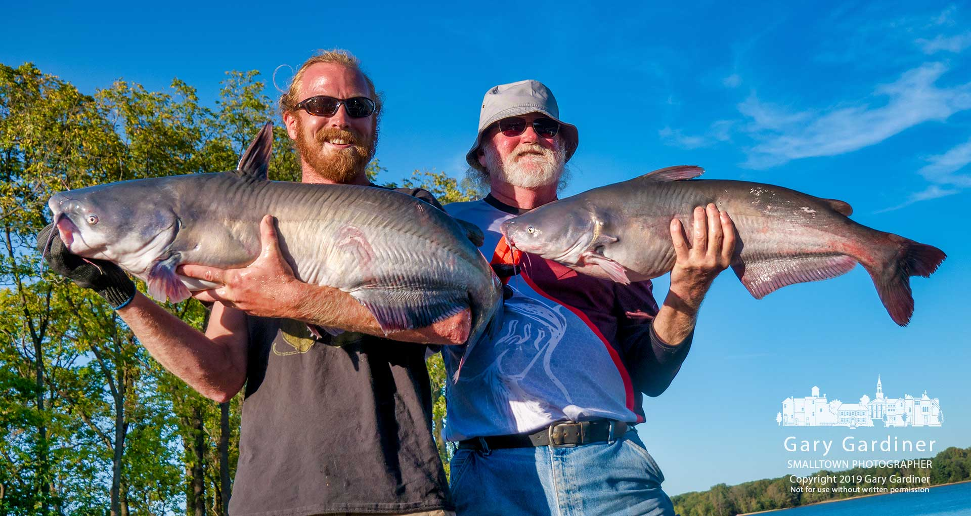 A pair of fishermen display their catch after weigh-in at the Flathead Blue catfish tournament Saturday at Hoover Reservoir. My Final Photo for Sept. 14, 2019.