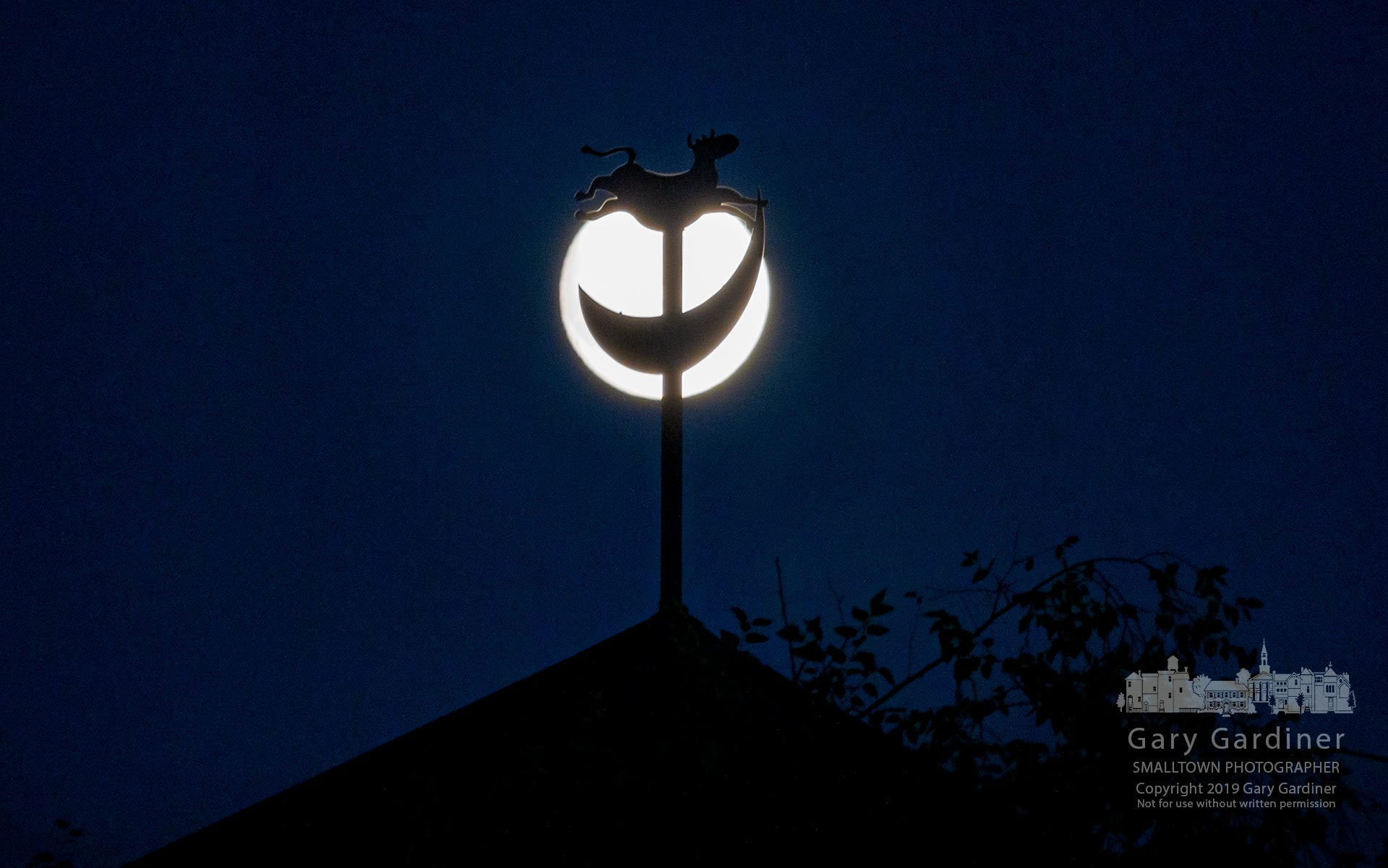 The decorative weather vane/lightning rod at the peak of the roof at Nationwide Childrens Hospital in Westerville is silhouetted against a nearly full moon. My Final Photo for Sept. 12, 2019. (Editors Note: This was practice for tomorrow's full moon but the forecast is for 75% cloud cover about the same time I'd shoot this. Didn't want to waste it.)