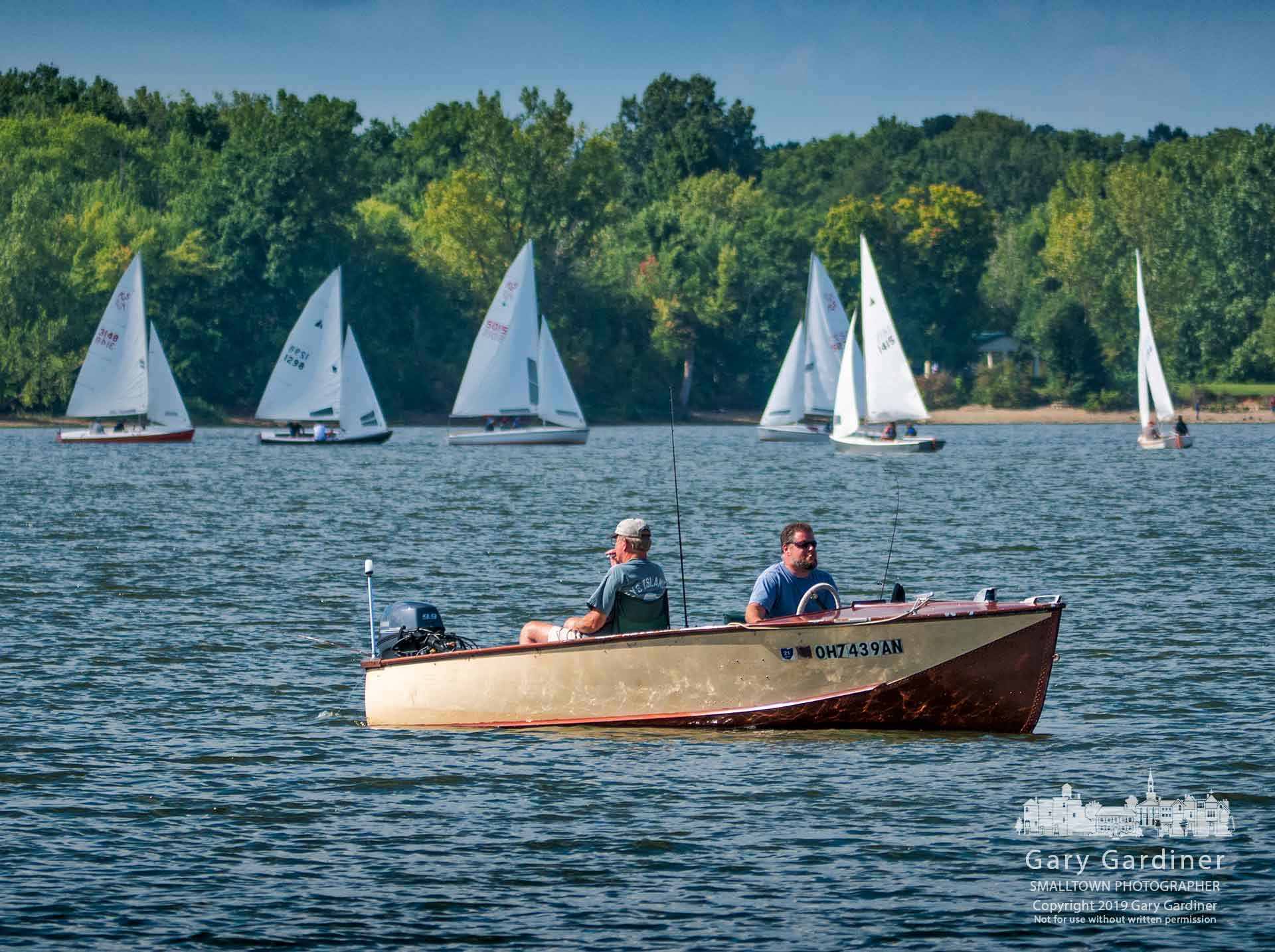 A pair of anglers navigate themselves around a flotilla of sailors challenging each other in the Labor Day club racing series on a near-perfect day for both fishing and sailing. My Final Photo for Sept. 2, 2019.