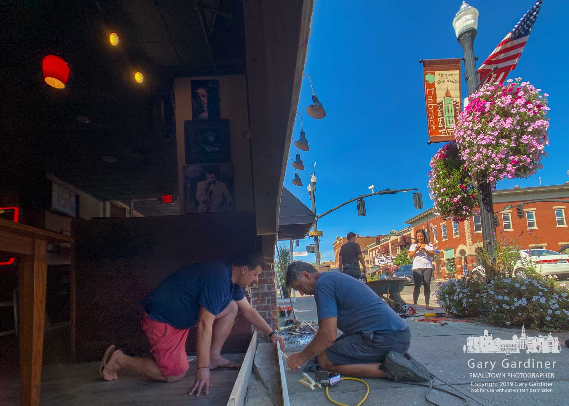 Mario Nedelkoski, left, talks with the carpenter building the form for a footer that will hold the new window being installed at Jimmy V's after the old window was destroyed in a car crash. My Final Photo for Sept. 17, 2019.