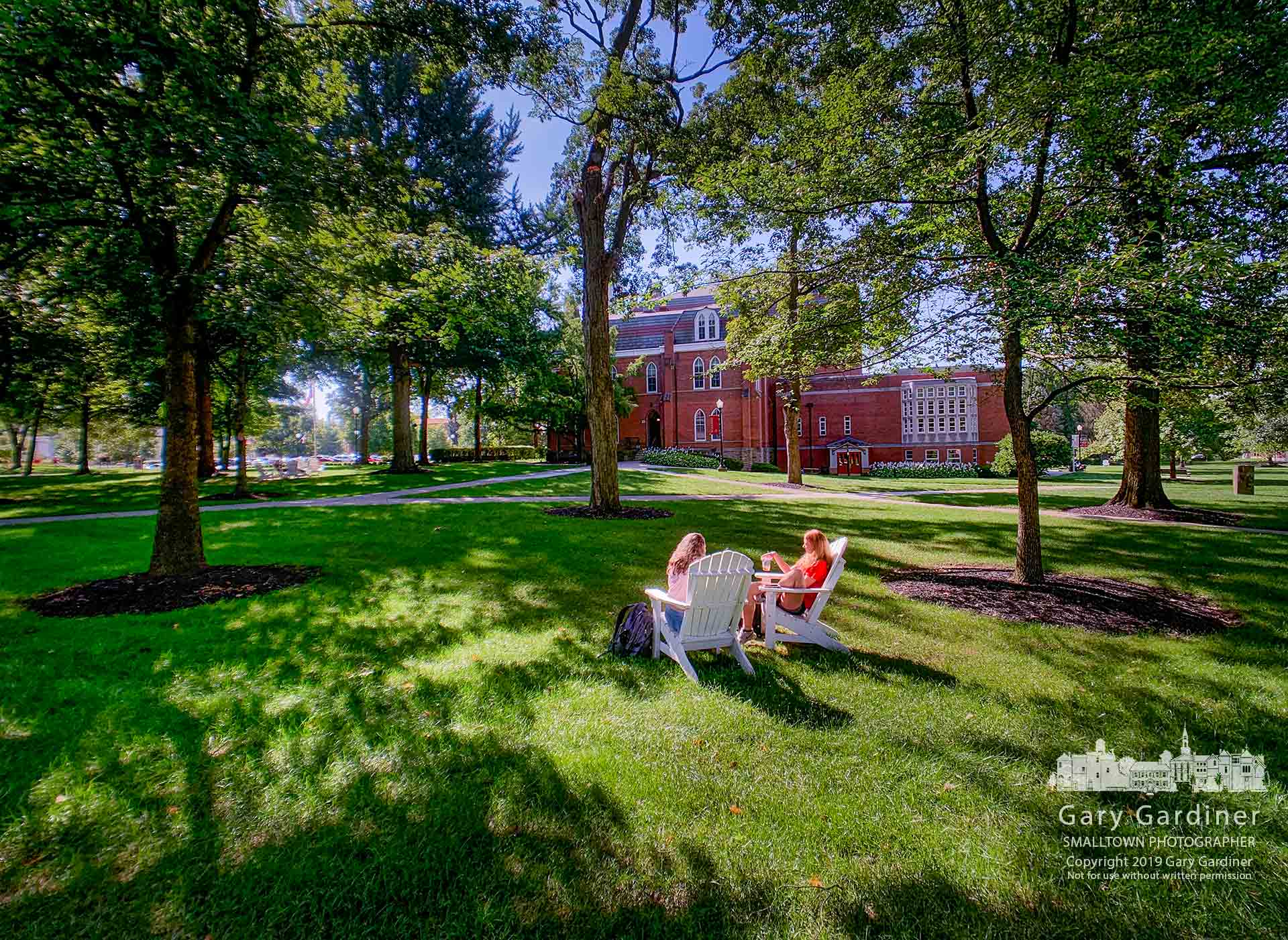Two Otterbein students take a break on campus with a rest in the Adirondack chairs the school has placed on the lawns around campus. My Final Photo for Sept. 3, 2019.