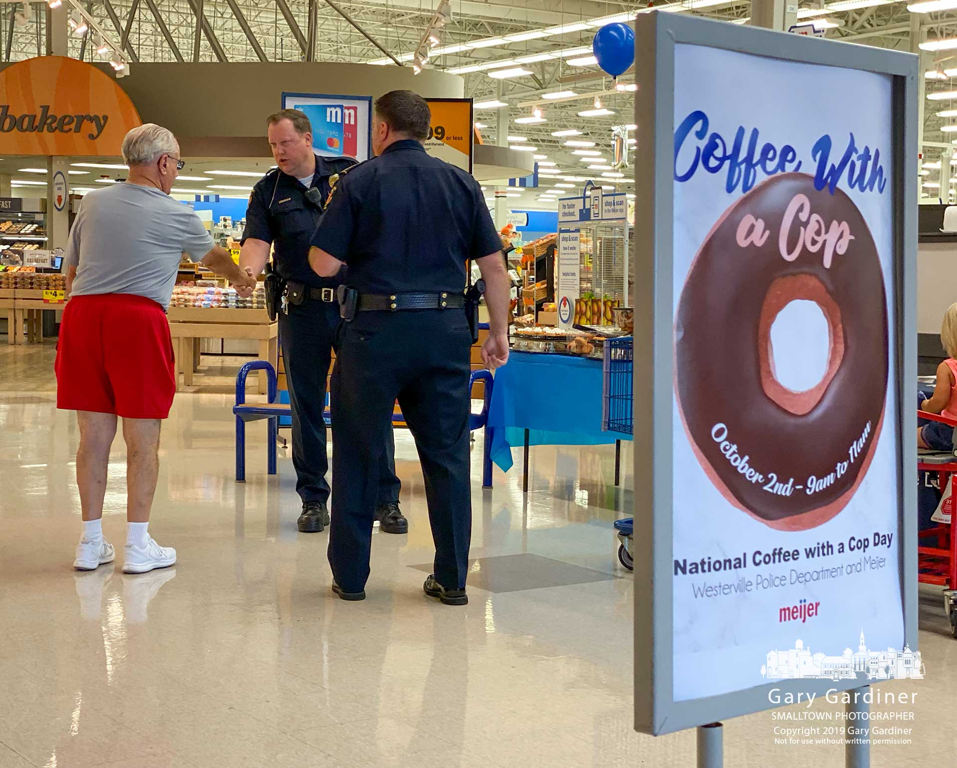 Westerville police officers greet a customer at Meijer during Coffee With A Cop Day. My Final Photo for Oct. 2, 2019.