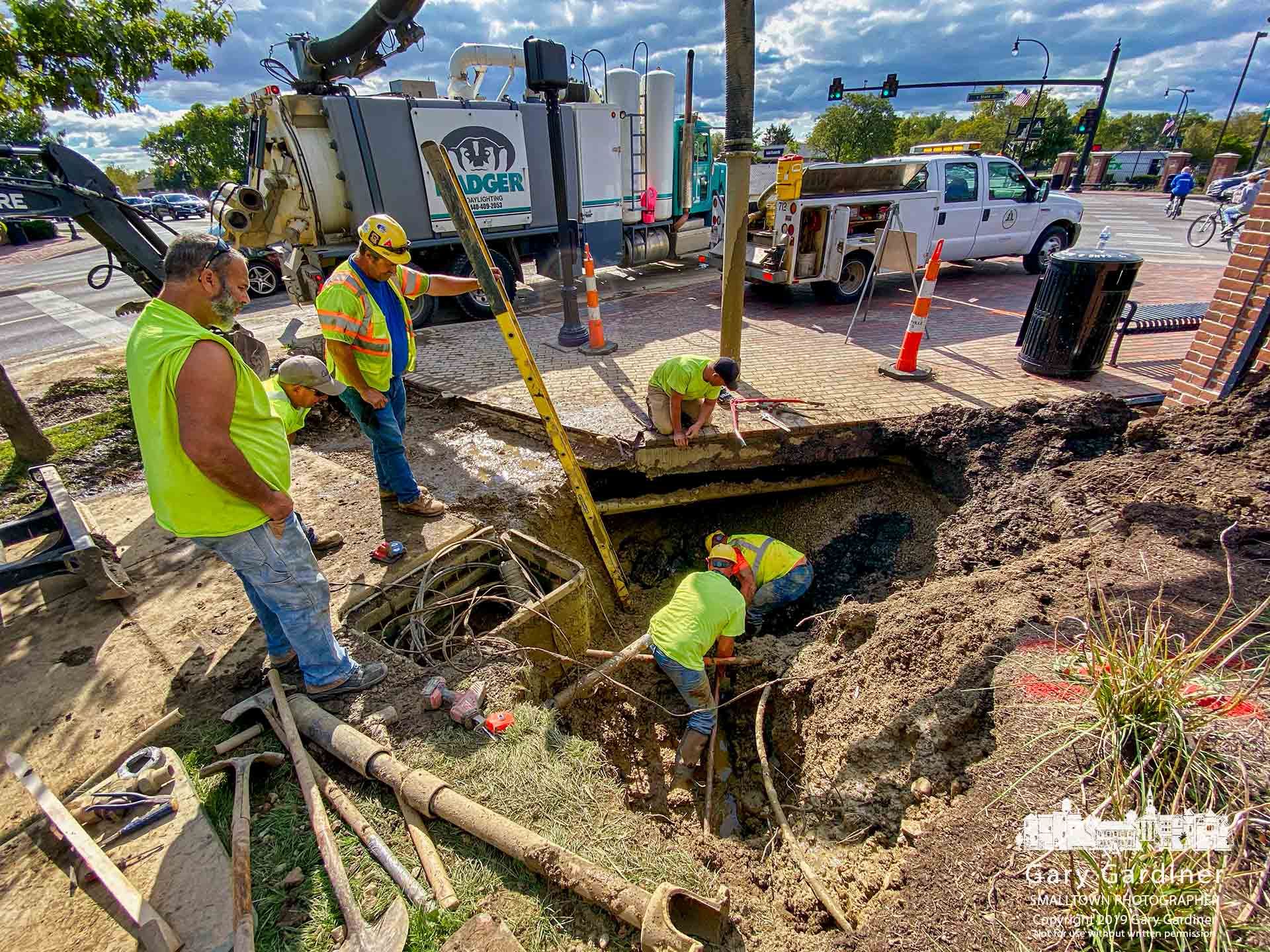 A work crew repairs the leaking water line that leads to the new First Watch restaurant being built at State and Huber Village Blvd. in Westerville. My Final Photo for Oct. 4, 2019. Photo Copyright 2019 Gary Gardiner. Not to be used without written permission detailing exact usage. Photos from Gary Gardiner, may not be redistributed, resold, or displayed by any publication or person without written permission. Photo is copyright Gary Gardiner who owns all usage rights to the image.