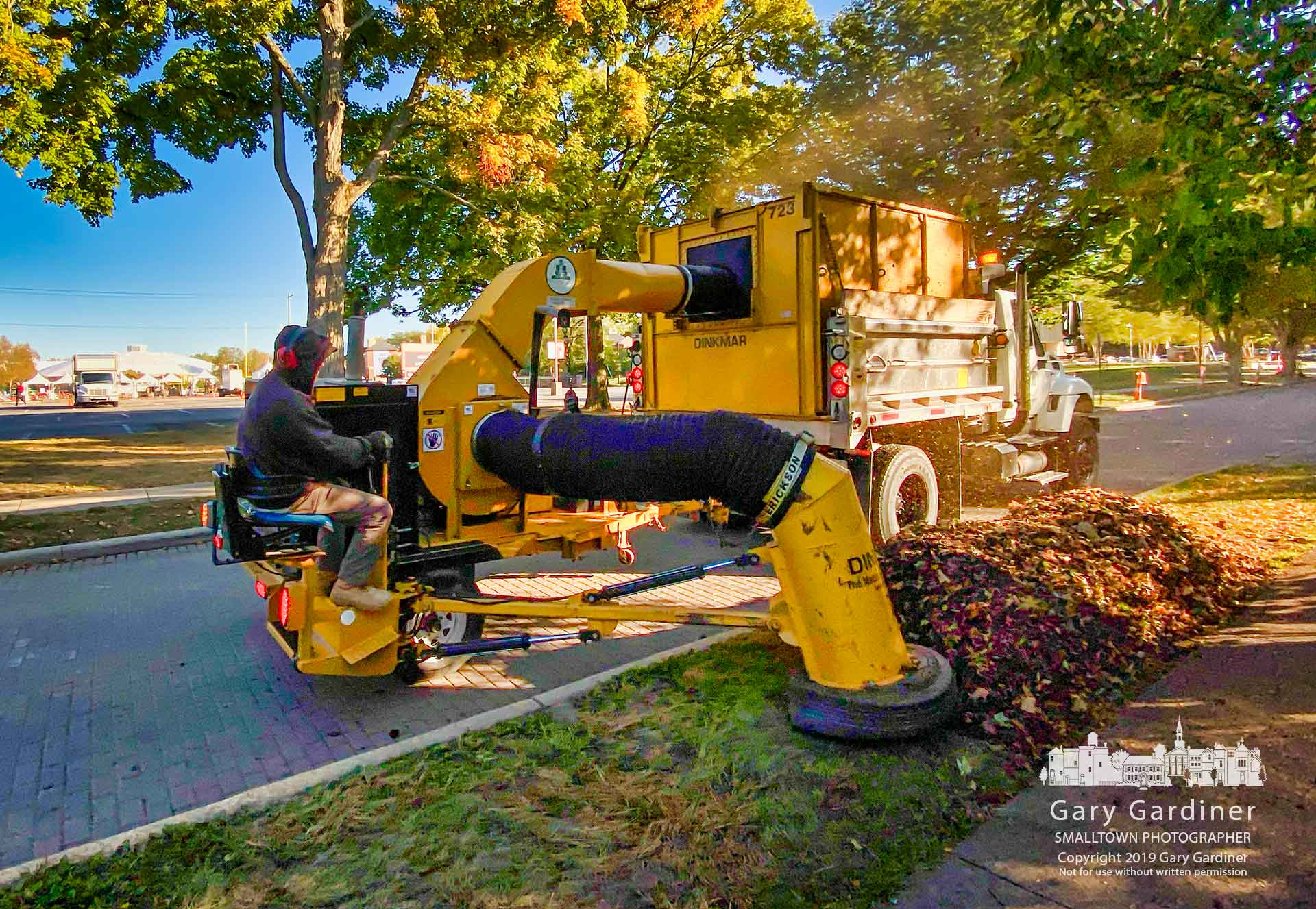 A city work crew began leaf collection a few days early clearing leaves along Home Street near Otterbein University where the Democratic presidential debate will be held Tuesday. My Final Photo for Oct. 14, 2019.