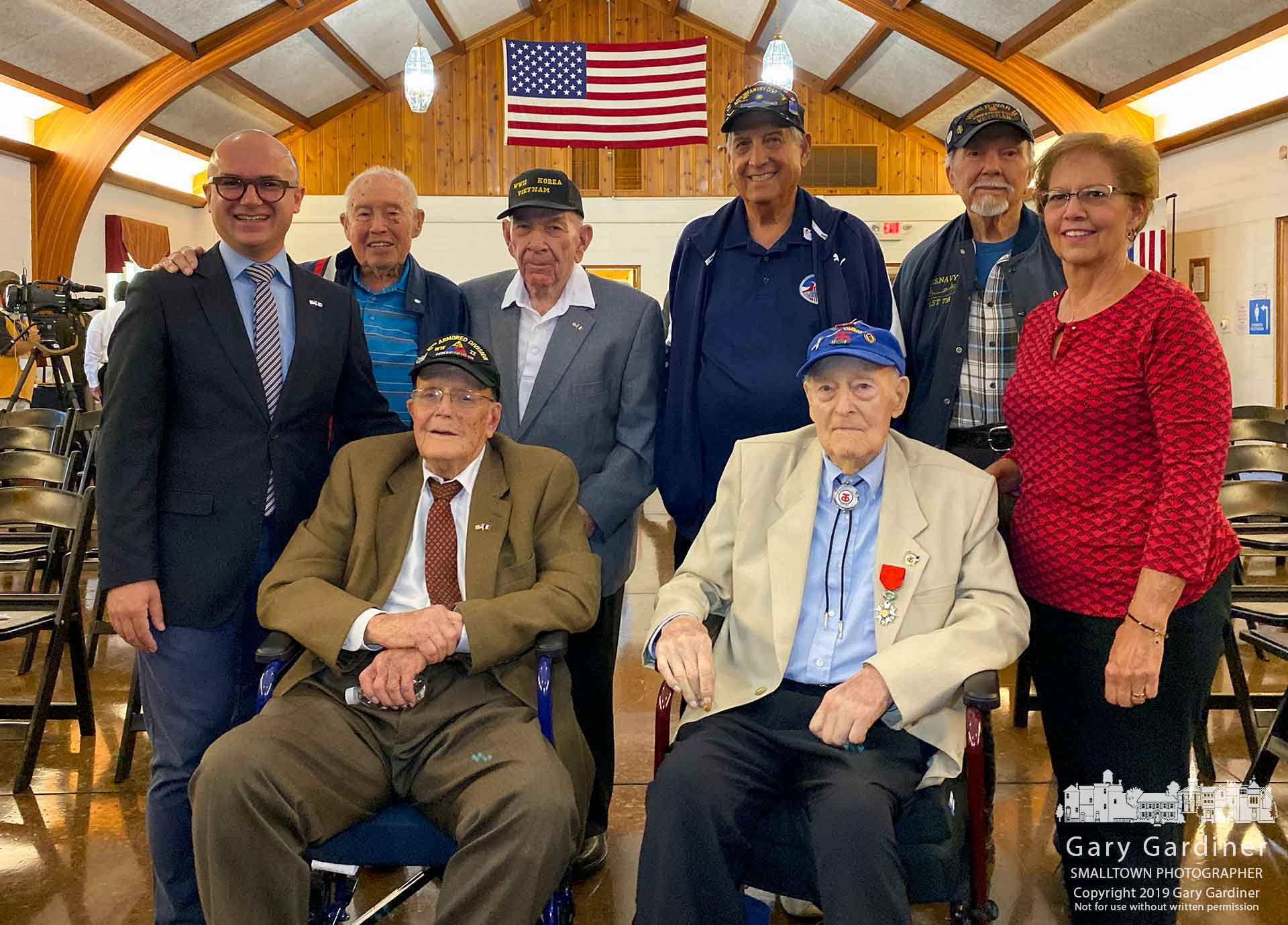 Hon. Guillaume Lacroix, left, Consul General of France to the Midwest, stands with World War II veterans after presenting the French Legion of Honor to John Jay, seated at right next to his daughter, in ceremonies at the American Legion Hall in Westerville. My Final Photo for Oct. 8, 2019.