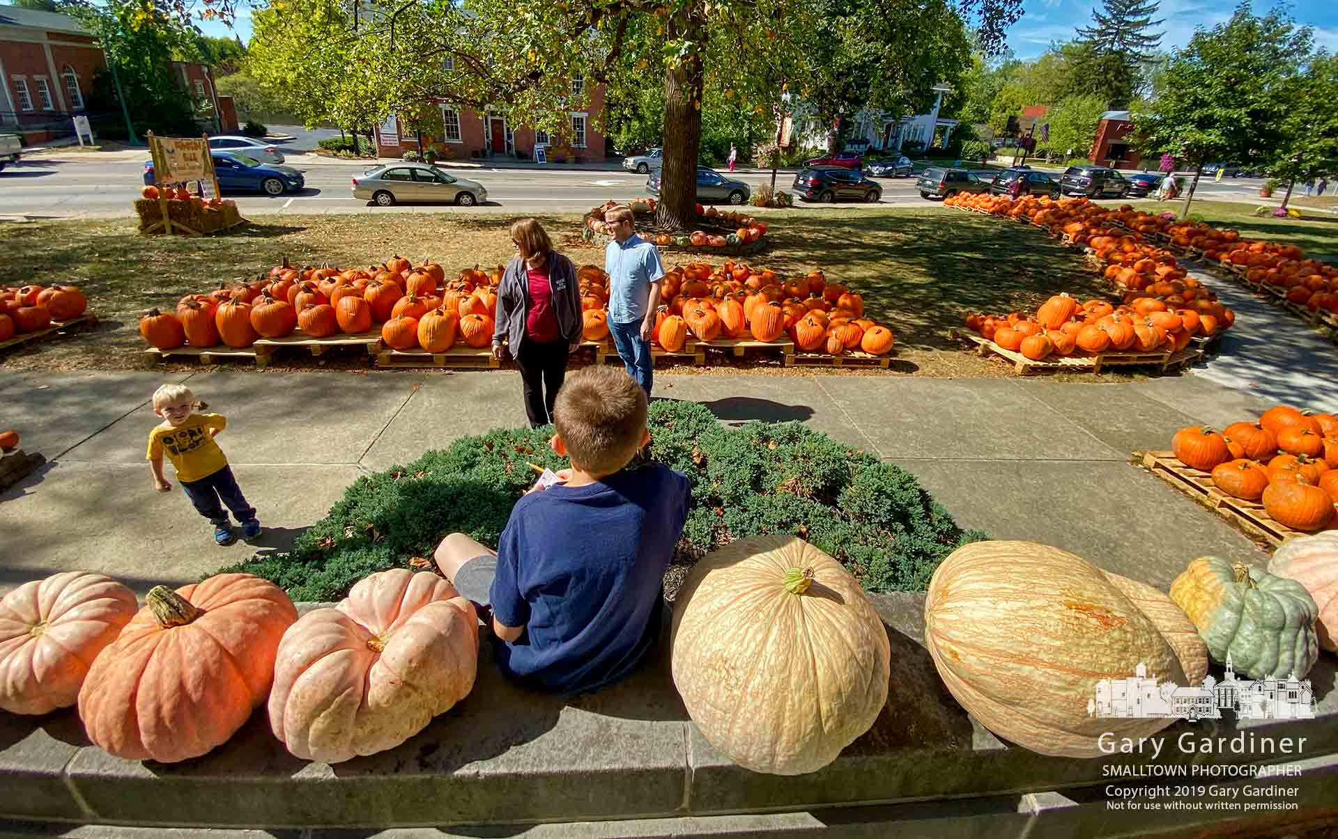 A family looks over the large selection of pumpkins at Westerville Troop 560's annual sale displayed in front of Masonic Hall on South State Street. My Final Photo for Oct. 5, 2019.
