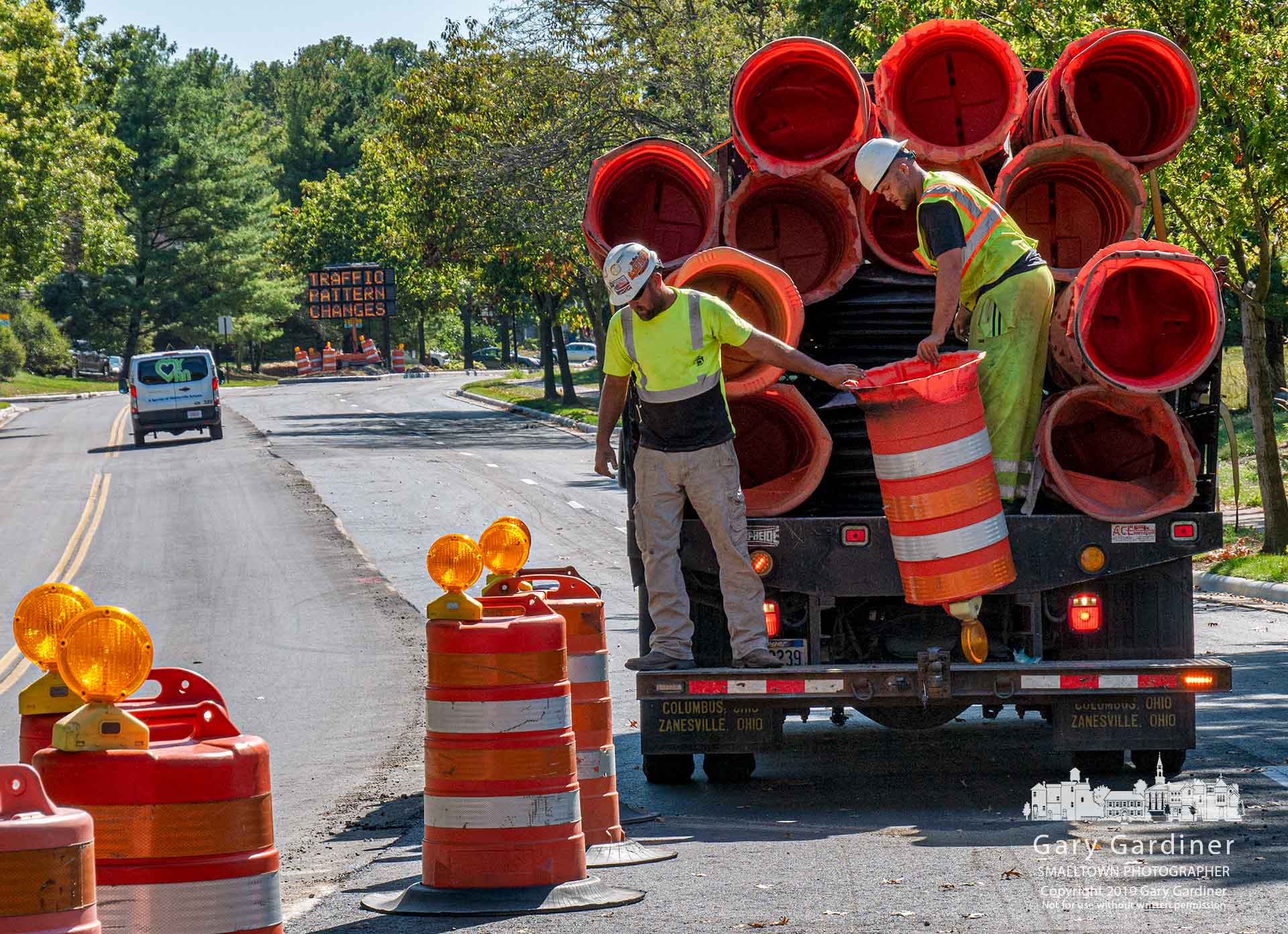 A road work crew removes the orange barrels from Spring Road to open the street both directions after most of the rebuilding of the road was completed Wednesday. My Final Photo for Oct. 9, 2019.