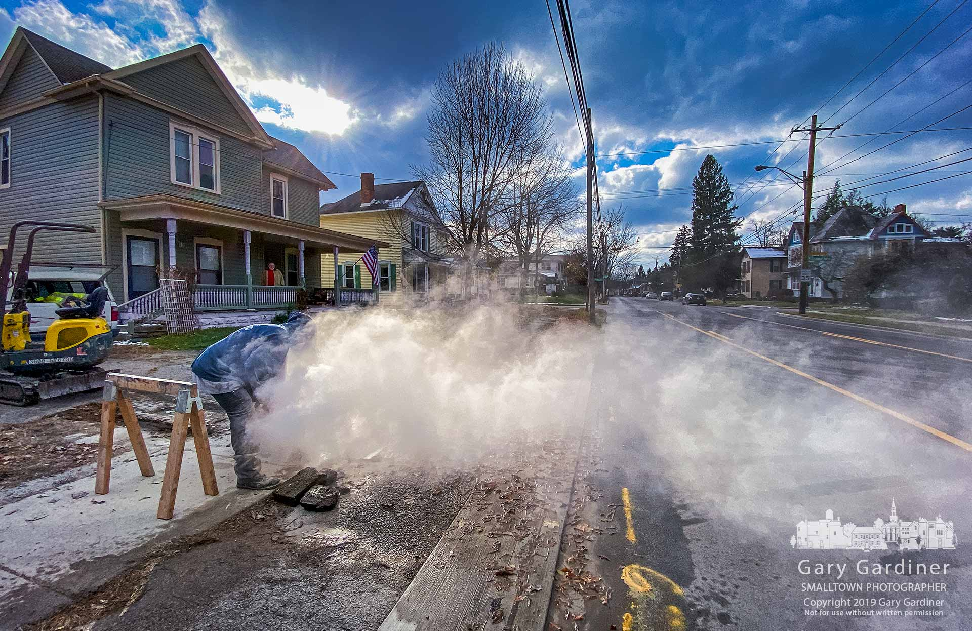 Concrete dust floats across State Street Saturday morning where a contractor cuts away a section of sidewalk to repair a broken water main. My Final Photo for Nov. 16, 2019.