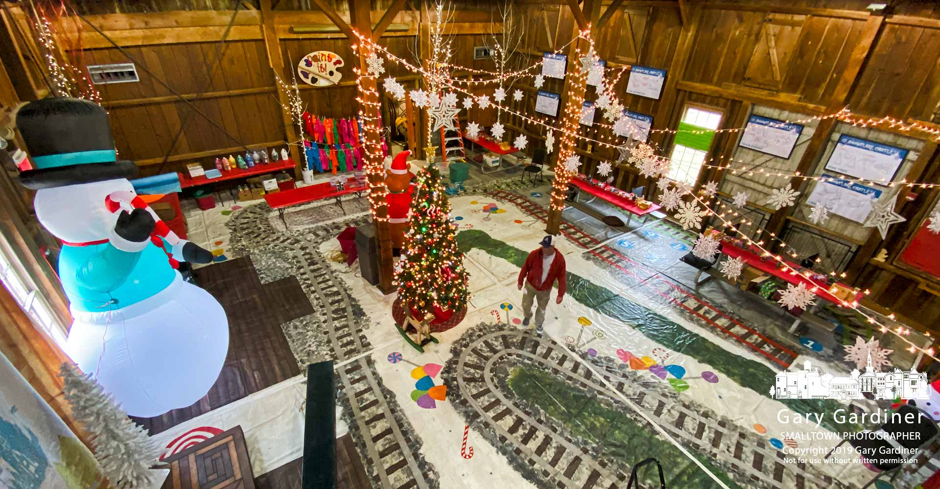 A volunteer worker walks through the main floor of the Everal Barn after it was decorated for Snowflake Castle, Westerville's annual Christmas season celebration for children who get to make their own toys and have a seat in Santa Claus's lap. My Final Photo for Nov. 26, 2019.