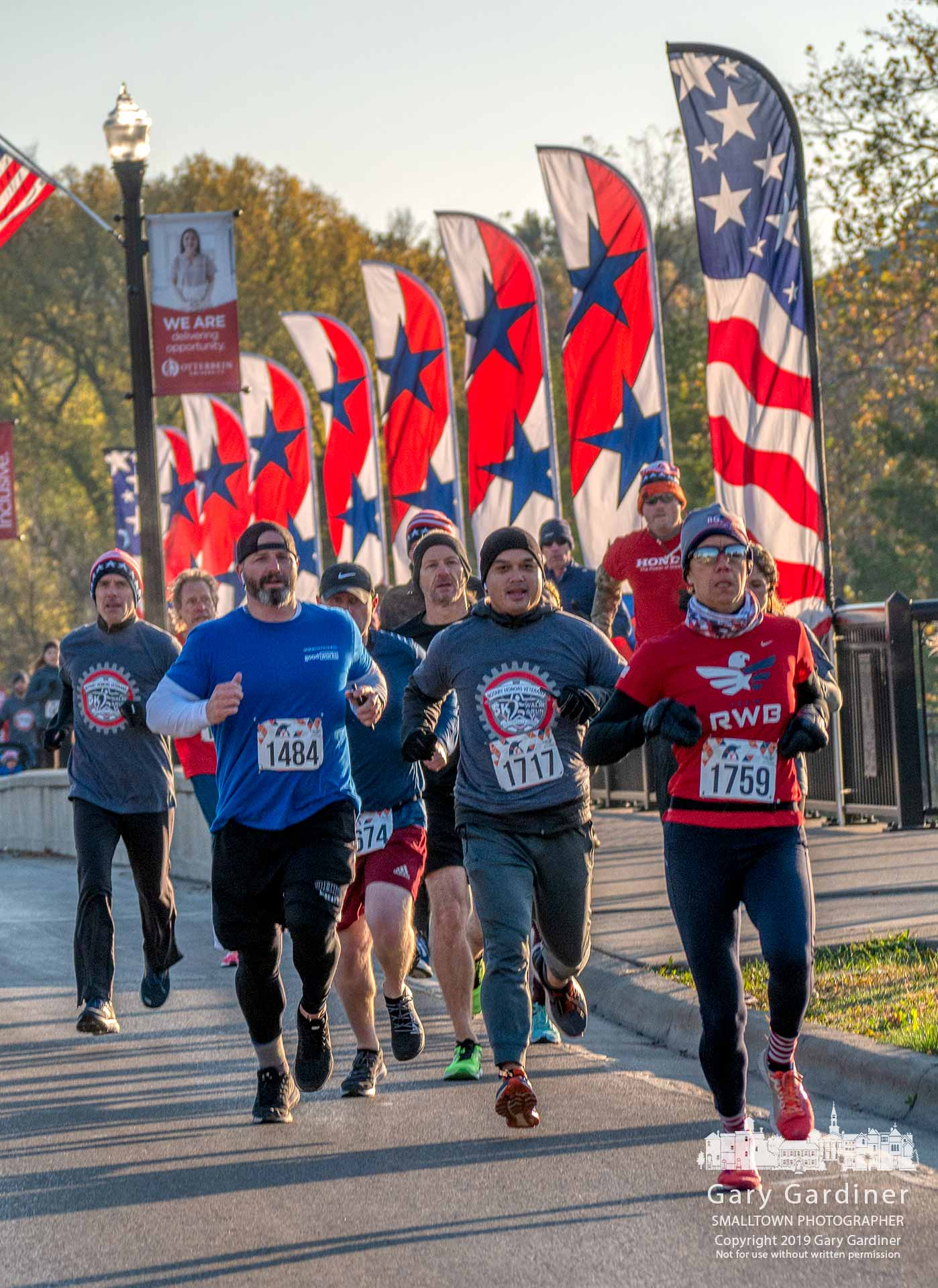 A group of runners crosses the Main Street bridge leading the pack in the Rotary Honors Veterans 5k Run early Saturday morning. My Final Photo for Nov. 2, 2019.