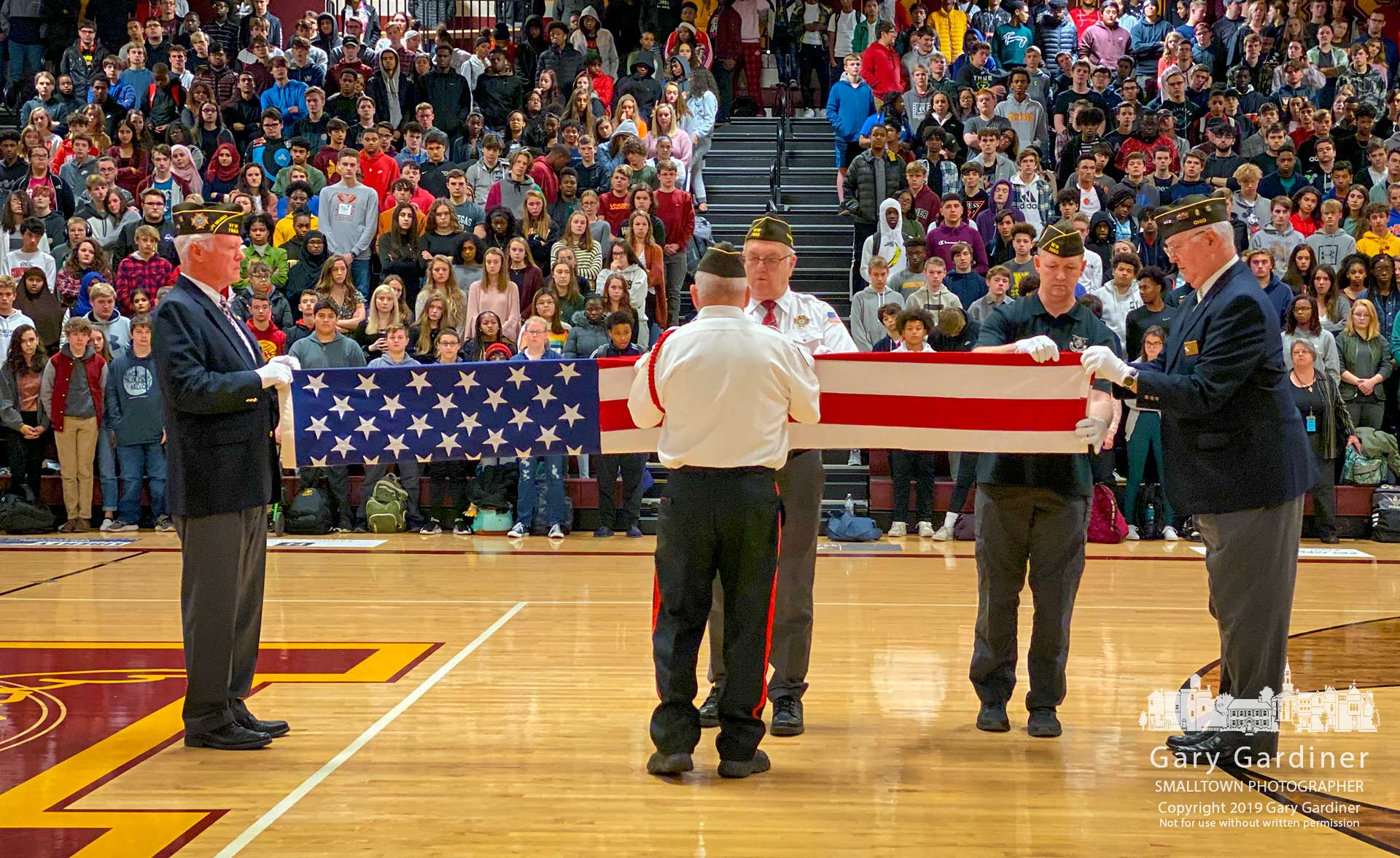 Veterans from Westerville VFW Post 7883 demonstrate and explain folding the American flag during a Veterans Day celebration at Westerville North High School. My Final Photo for Nov. 11, 2019.