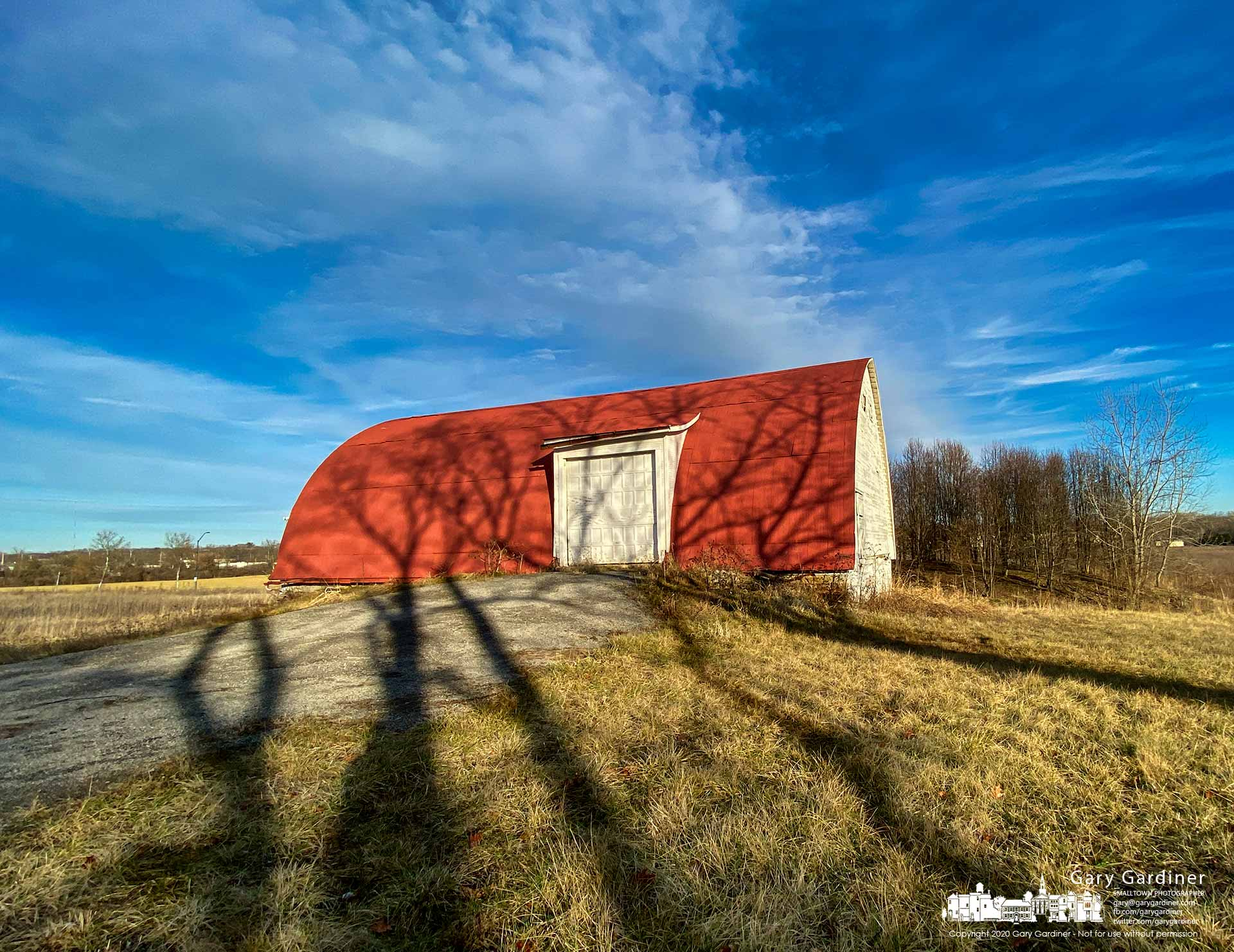 Shadows from the walnut trees behind the farmhouse on the Braun Farm cast themselves in unusual shapes toward the barn on a warm winter afternoon. My Final Photo for Jan. 6, 2020.