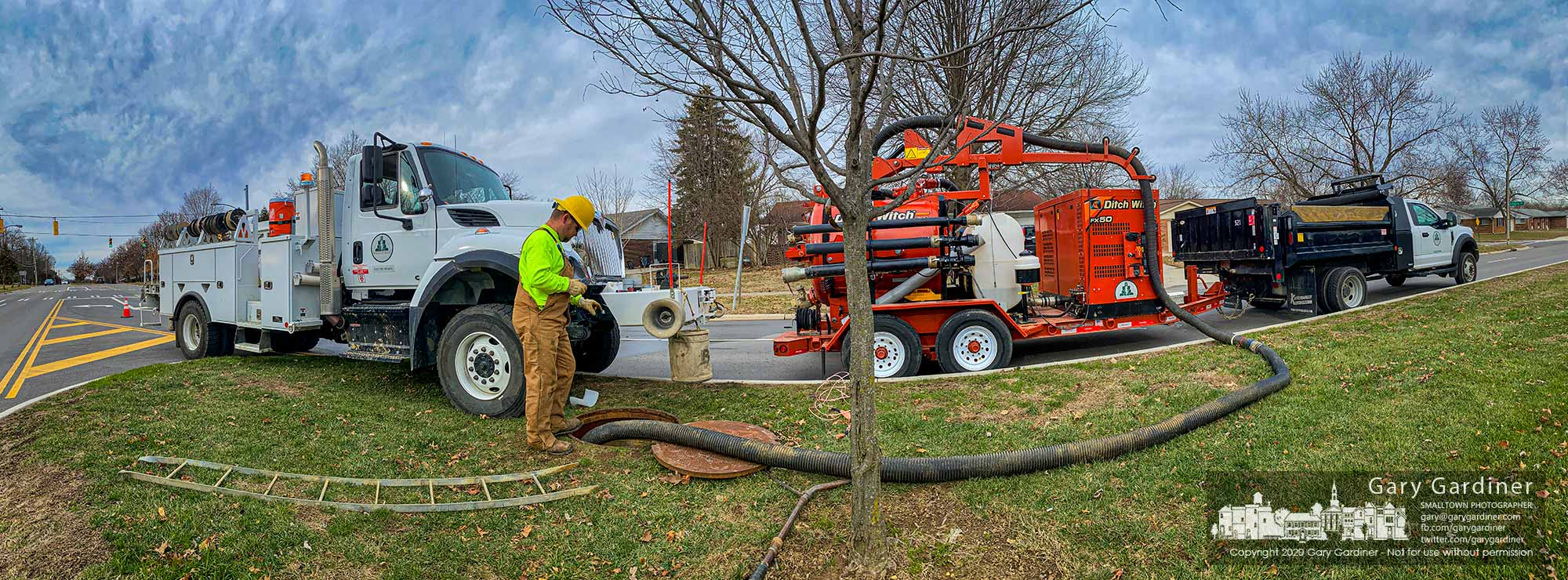 A Westerville city electric crew pulls a fiber sleeve for data cables through conduit beneath Huber Village Blvd. and Eastwind Dr. as the city expands its data capability in the south end of the city. My Final Photo for Jan. 9, 2020.