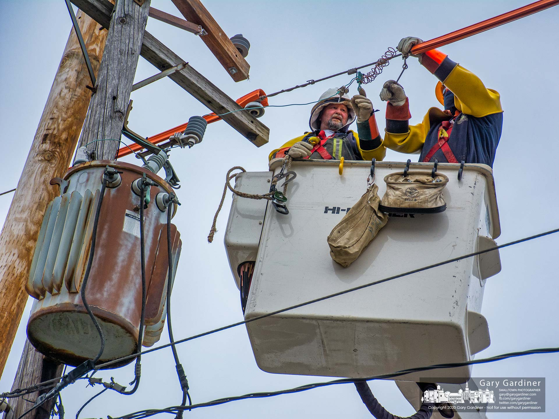 Westerville electric workers wearing safety gear isolating them from the power line prepare to move live cabling from to a new pole replacing an aged and decayed pole on South State Street. My Final Photo for Jan. 30, 2020.