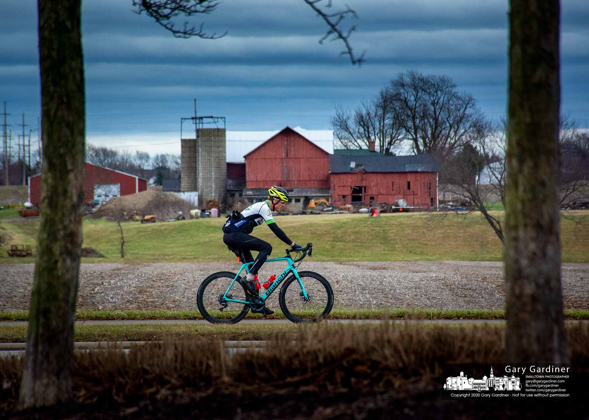 A cyclist passes the lower acres below the Yarnell farm barns as he works his way through an energetic ride on an unusually warm mid-January day. My Final Photo for Jan. 11, 2020.
