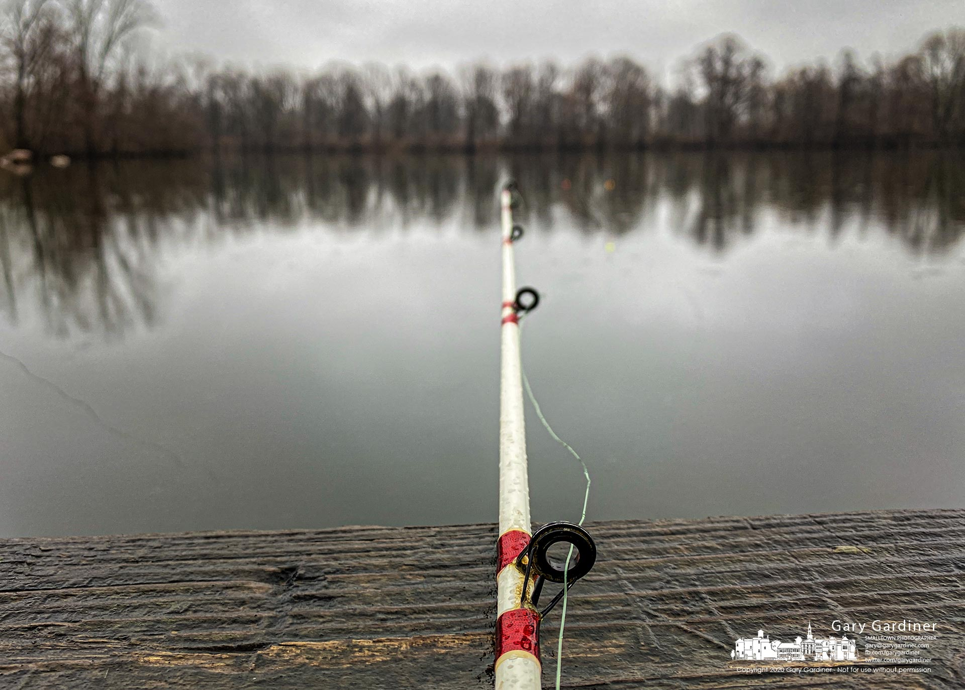 A slack line indicates both the stillness of the waters at Schrock Lake and this fisherman's success on a rainy Friday afternoon. My Final Photo for Jan. 3, 2020.