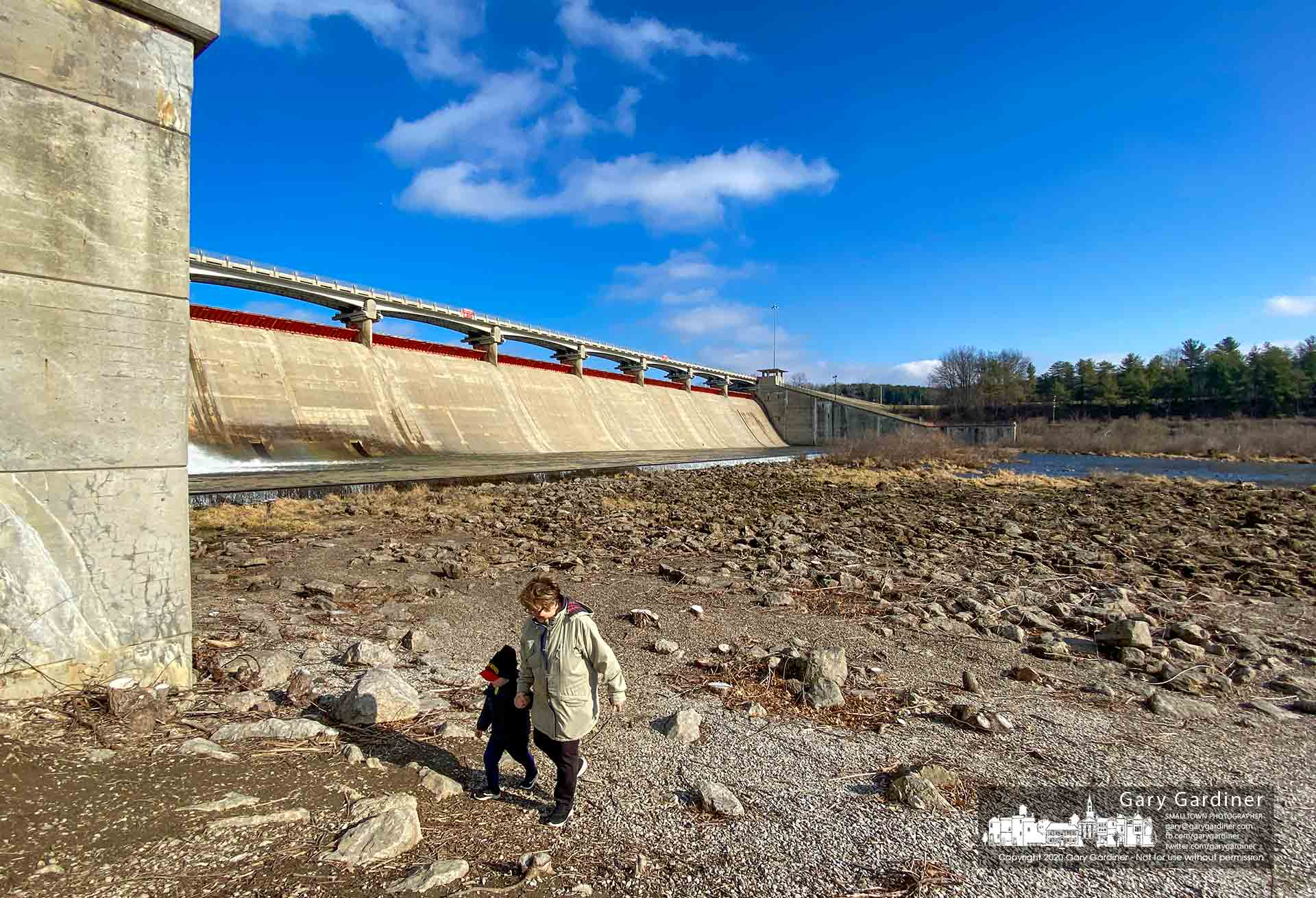 A woman and her grandson walk back to the parking lot after taking a closeup view of the base of Hoover Dam where the reservoir level has kept overflow at a minimum. My Final Photo for Jan. 14, 2020.
