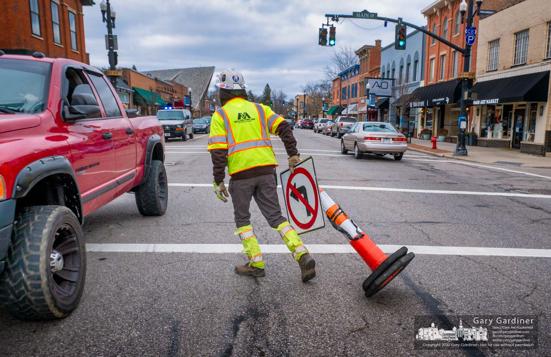 A Miller Pipeline worker removes the No Left Turn sign from State Street after the crew completed connecting new gas lines to the Holmes Hotel building. My Final Photo for Jan. 13, 2020.