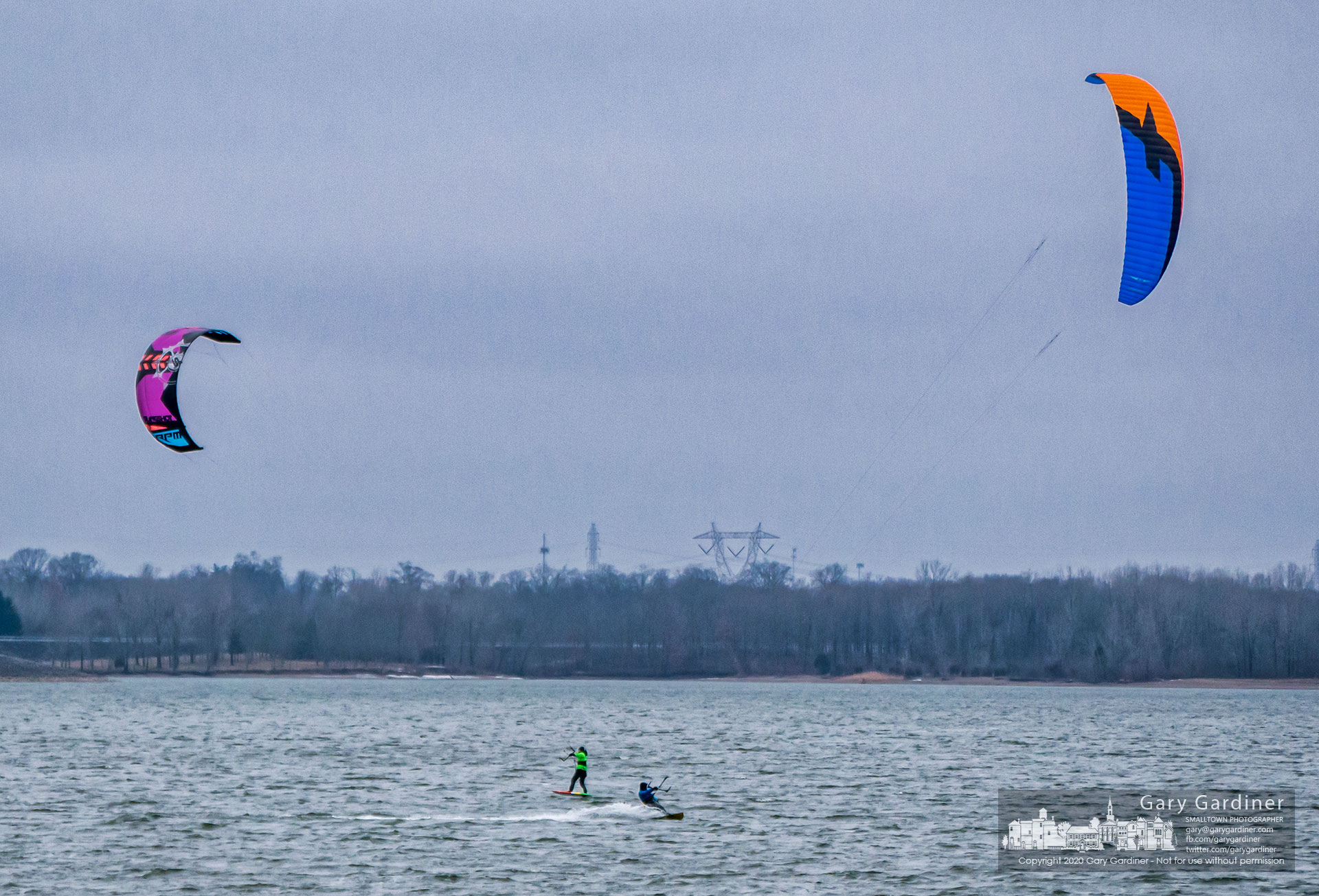 A pair of wetsuit clad kiteboarders pass each other on the wind-whipped, choppy waters of Alum Creek Lake on Sunday afternoon. My Final Photo for Jan. 26, 2020.