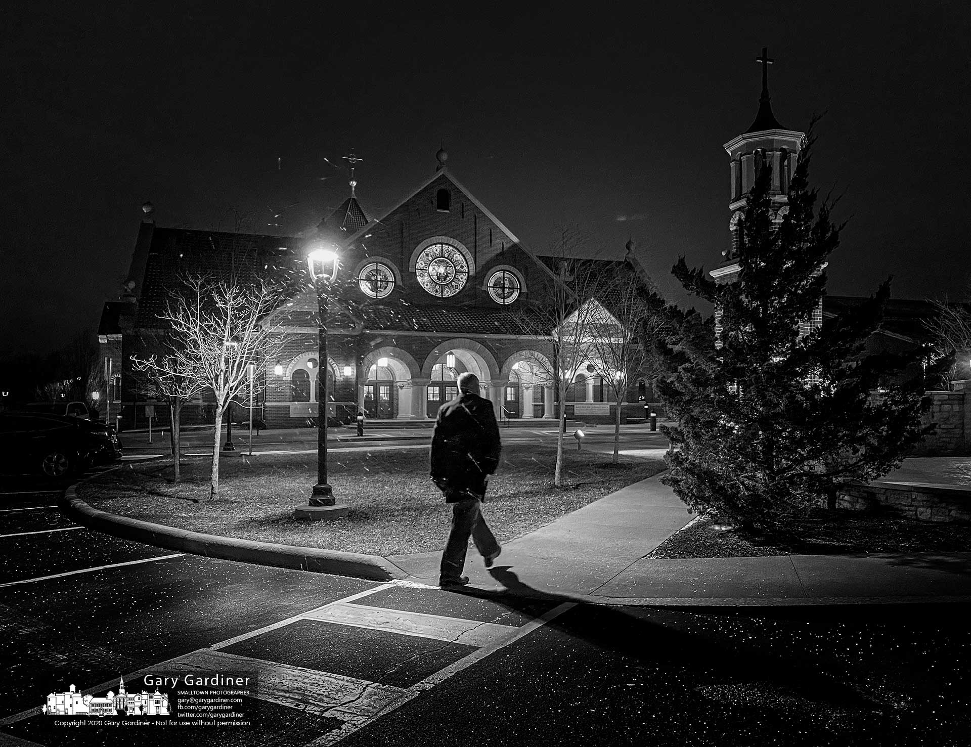 A parishioner walks toward St. Paul the Apostle Catholic Church as a stiff breeze wraps a snow squall around the church before the early morning Mass. My Final Photo for Jan. 19, 2020.