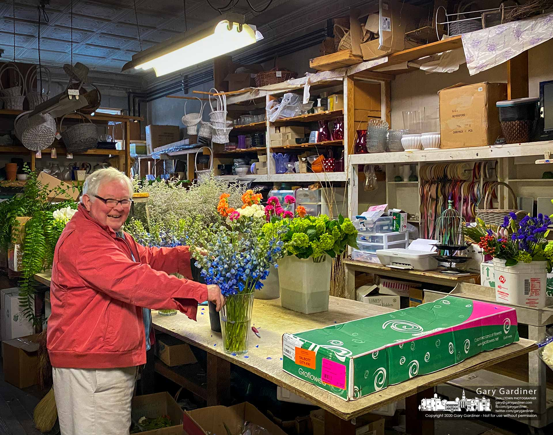 Uptown florist Dave Talbott shares a laugh as he works in his backroom creating another floral arrangement on a cool and rainy January afternoon. My Final Photo for Jan. 10, 2020.