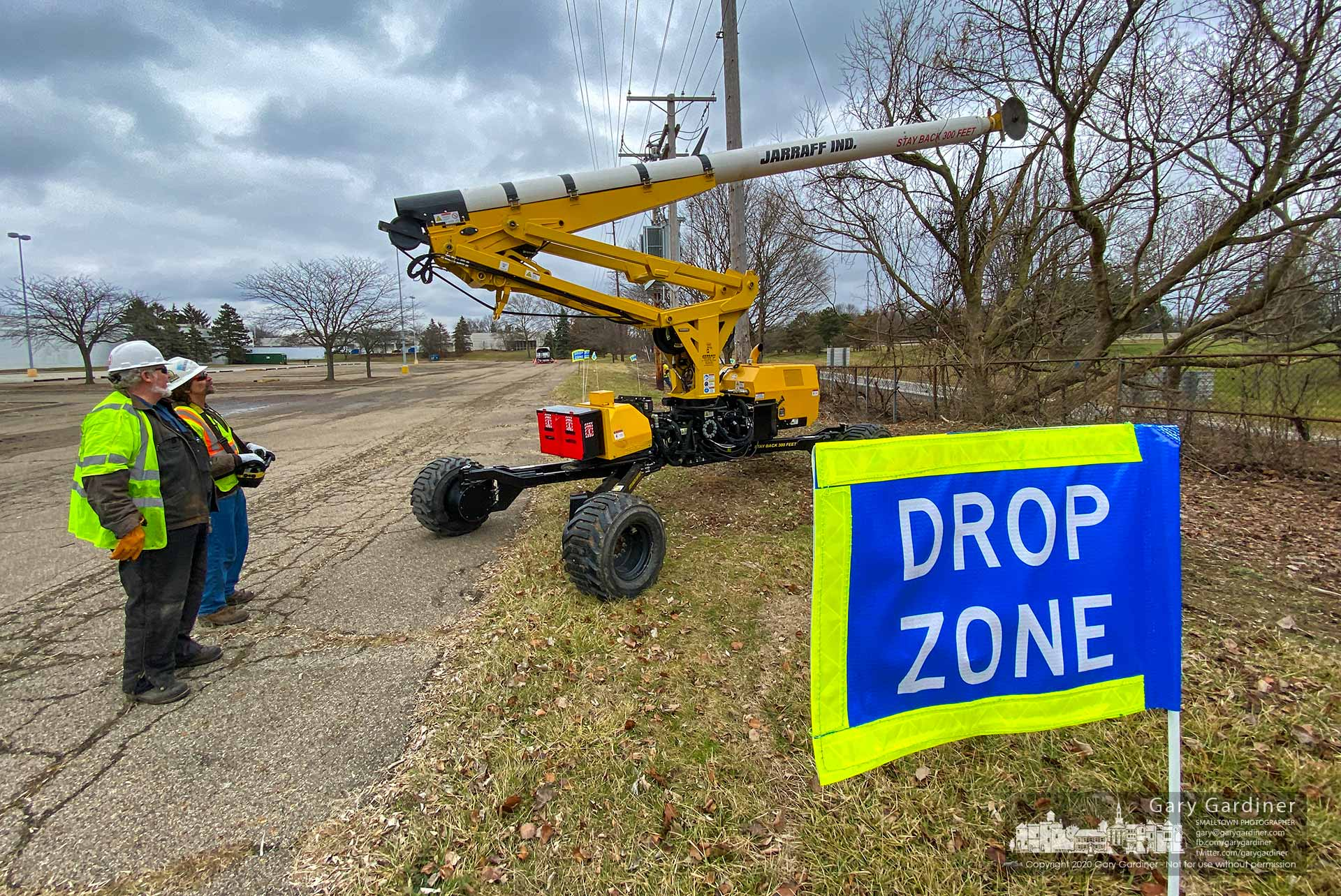 A set of boundary markers delineate the safety zone where a work crew uses a remote-controlled 24-inch circular saw blade on an extension arm to remove trees close to the AEP powerlines behind the Kohl's shopping center at Huber and State. My Final Photo for Jan. 28, 2020.