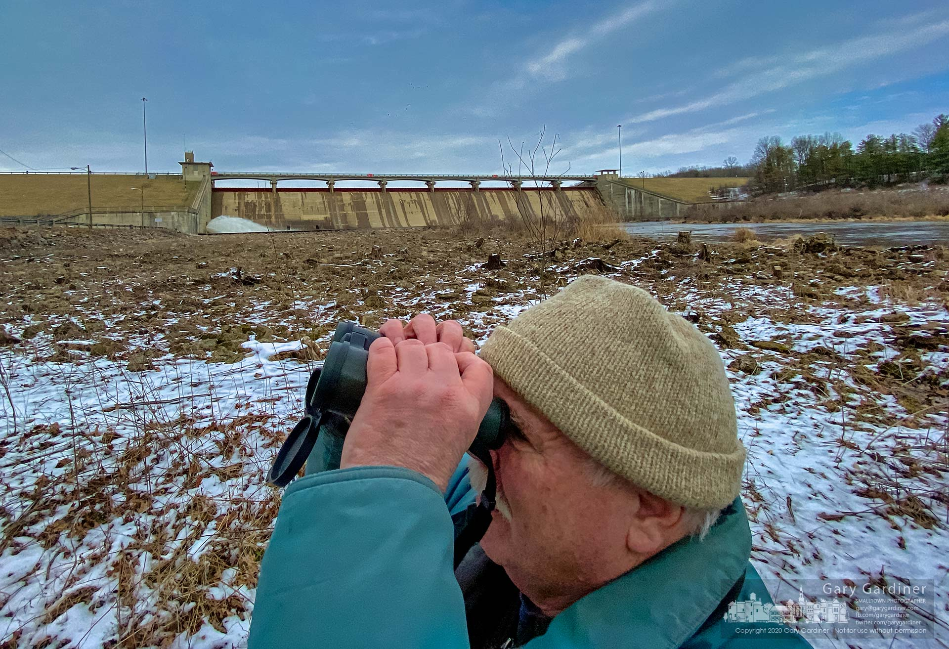 A birdwatcher visiting from Seattle successfully scans the trees below Hoover Dam for bluebirds, a rarity in Seattle. My Final Photo for Feb. 15, 2020.