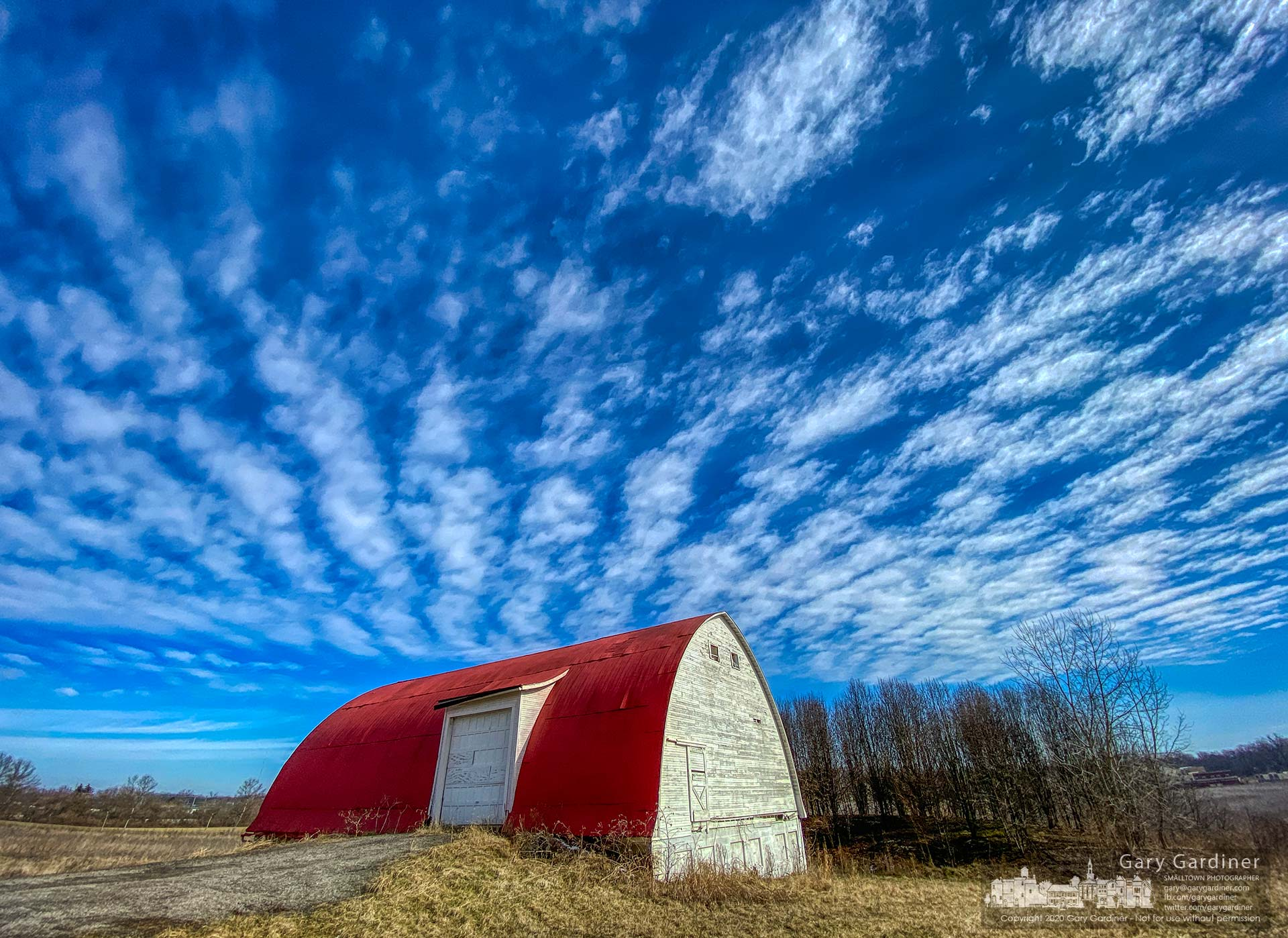 A thin layer of Altocumulus clouds drifts over the barn on the Braun Farm as slightly higher than normal temperatures brought warmth to a winters day. My Final Photo for Feb. 17, 2020.