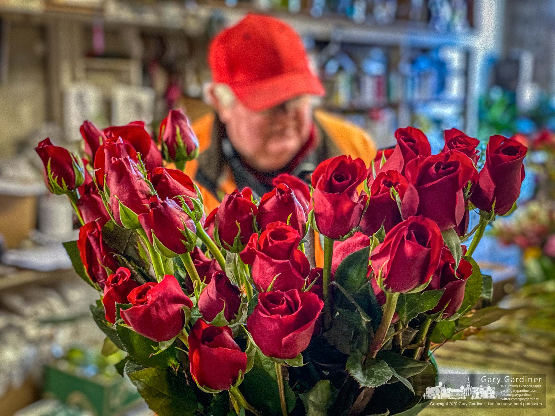 Florist Dave Talbott stands at his work table in the backroom of Talbotts Flowers where he spent the day preparing flowers, mostly roses, for others to show their affection for significant others and family. My Final Photo for Feb. 14, 2020.