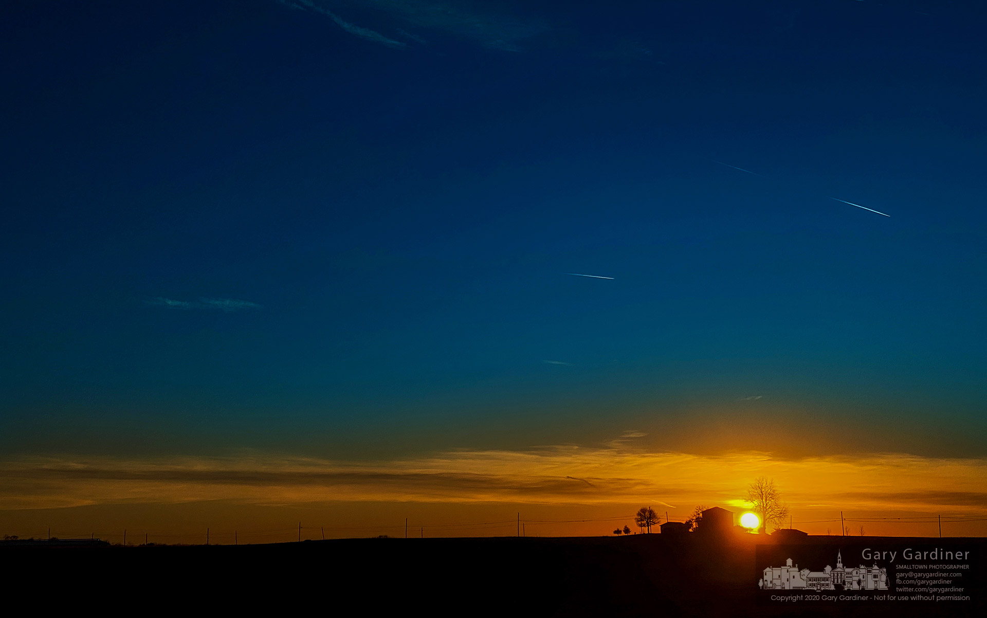 A warm winter day sun sets behind a farmhouse near Croton, Ohio. My Final Photo for Feb. 2, 2020.