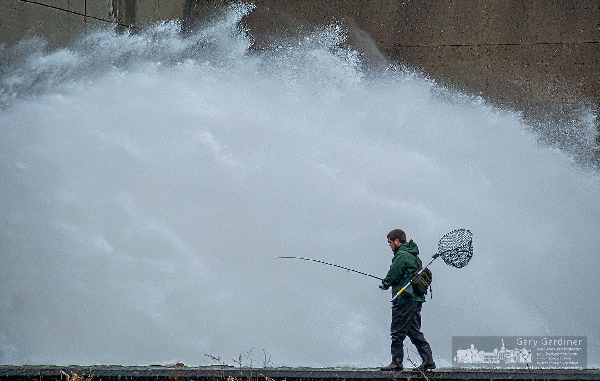 A fisherman casts into the waters below the spillway tunnel at the base of Hoover Dam hoping for better luck than his earlier foray near the center of the spillway. My Final Photo for Feb. 4, 2020.