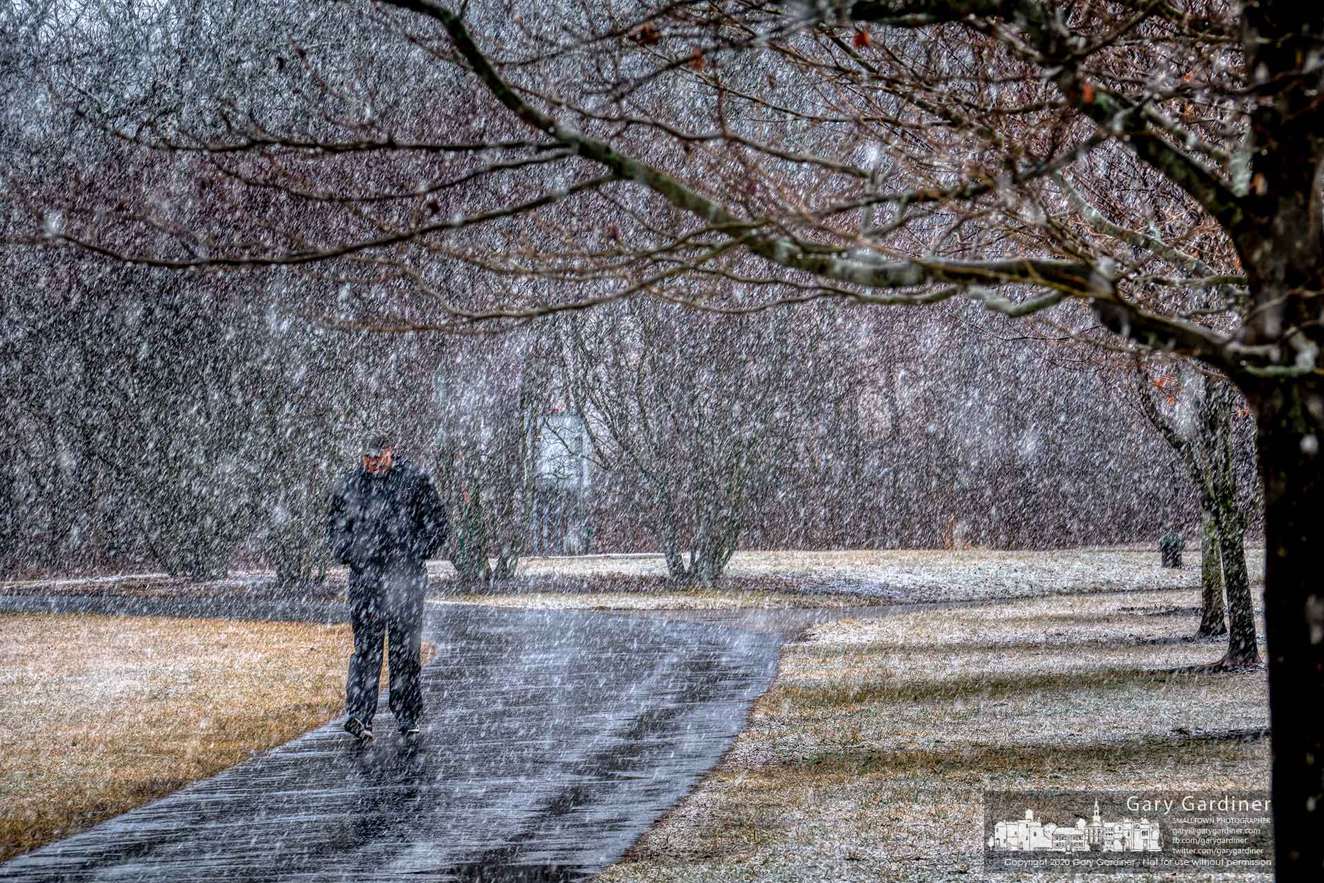 A man gets in his daily walk through heavy snow squalls across the fields at the Westerville Sports Complex on Cleveland Ave. My Final Photo for Feb. 26, 2020.