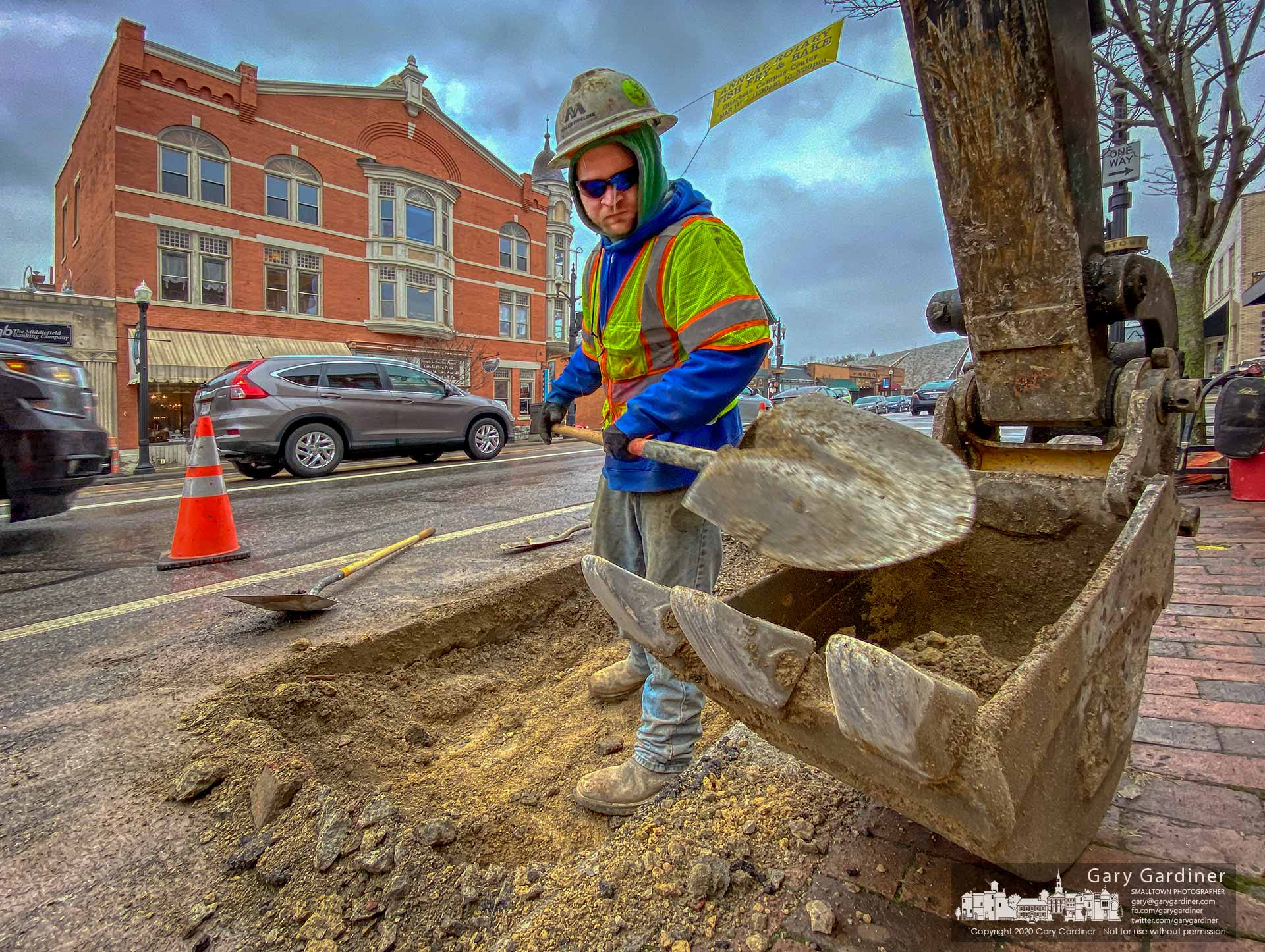 A Miller Pipeline worker uses a shovel to complete excavation of a section of State Street near Main to expose old natural gas lines that will be capped as the service is delivered recently installed pipeline at the rear of buildings in sections of Uptown. My Final Photo for Feb. 25, 2020.