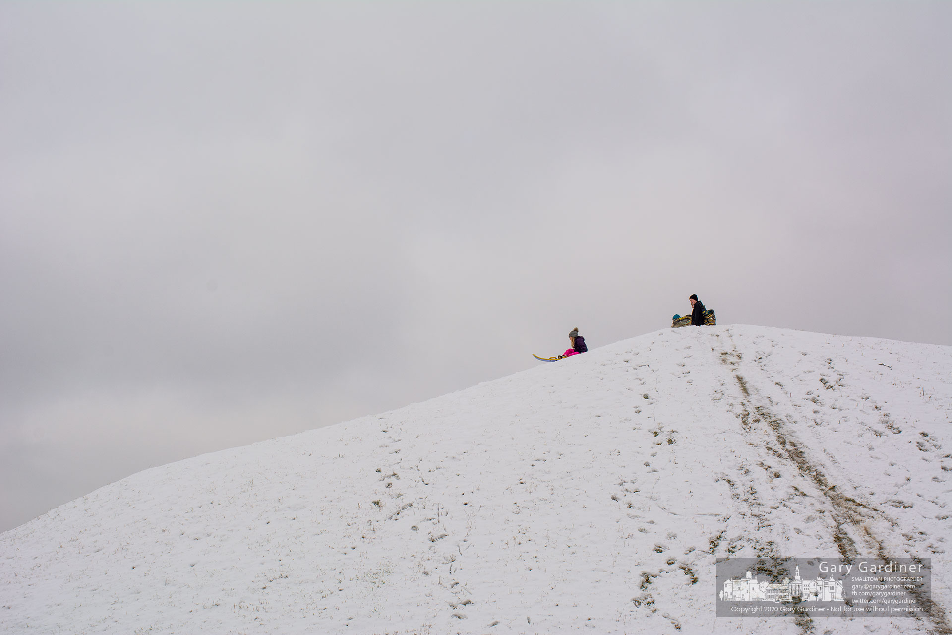 A young girl begins another run down the Parks and Rec's sledding hill on Park Meadow Drive after two days of snow showers left enough snow in the hill for a fun time. My Final Photo for Feb. 13, 2020.