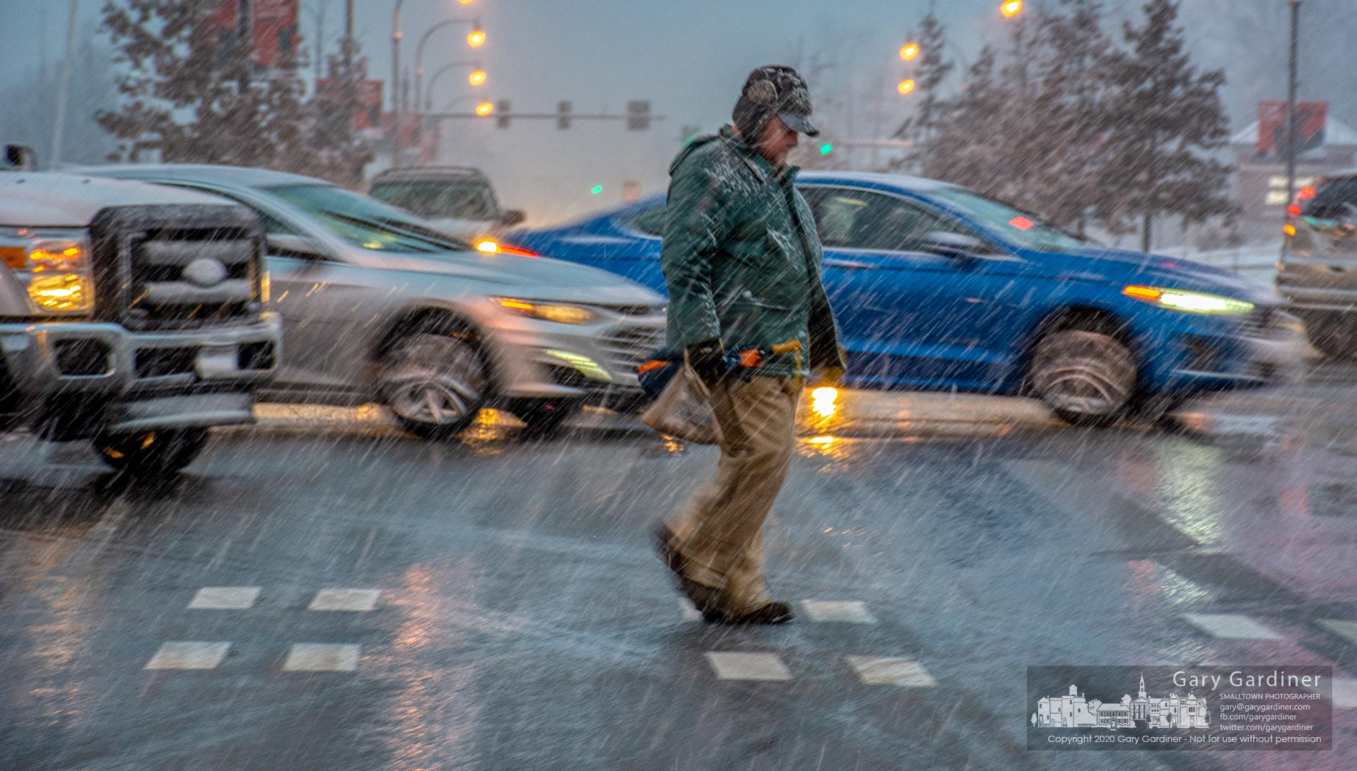 A man crosses State Street during rush hour and an accompany heavy snowfall as he makes his way to pick up a prescription before heading home. My Final Photo for Feb. 12, 2020.