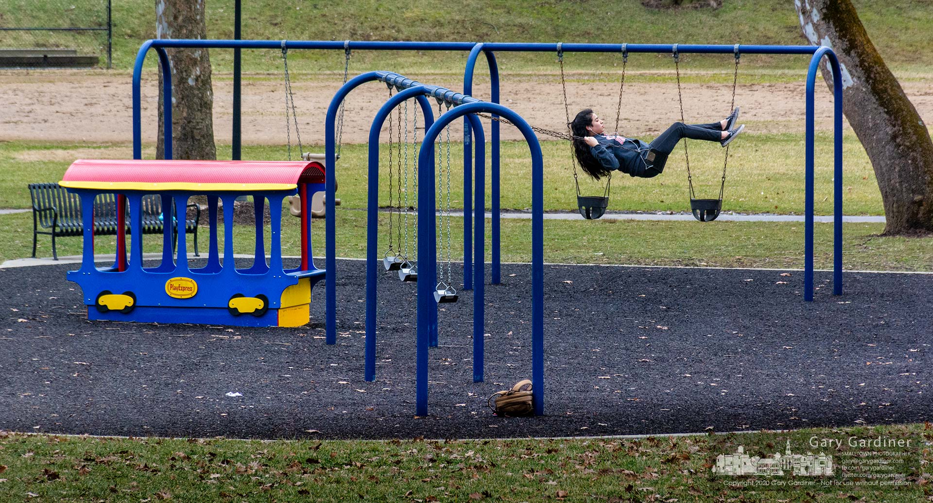 An Otterbein student takes time between classes to enjoy a break from studying with vigorous playtime on a swing at Alum Creek Park on West Main. My Final Photo for Feb. 5, 2020.