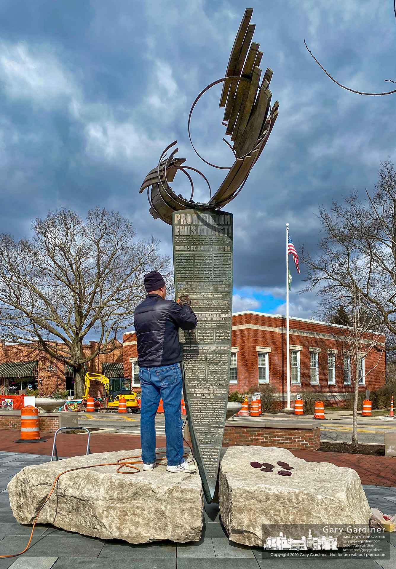 Westerville Law Director Bruce Bailey polishes The American Issue Sculpture by Matthew Gray Palmer severalo days before Spring begins. The sculpture was commissioned by Bailey. My Final Photo for March 15, 2020.