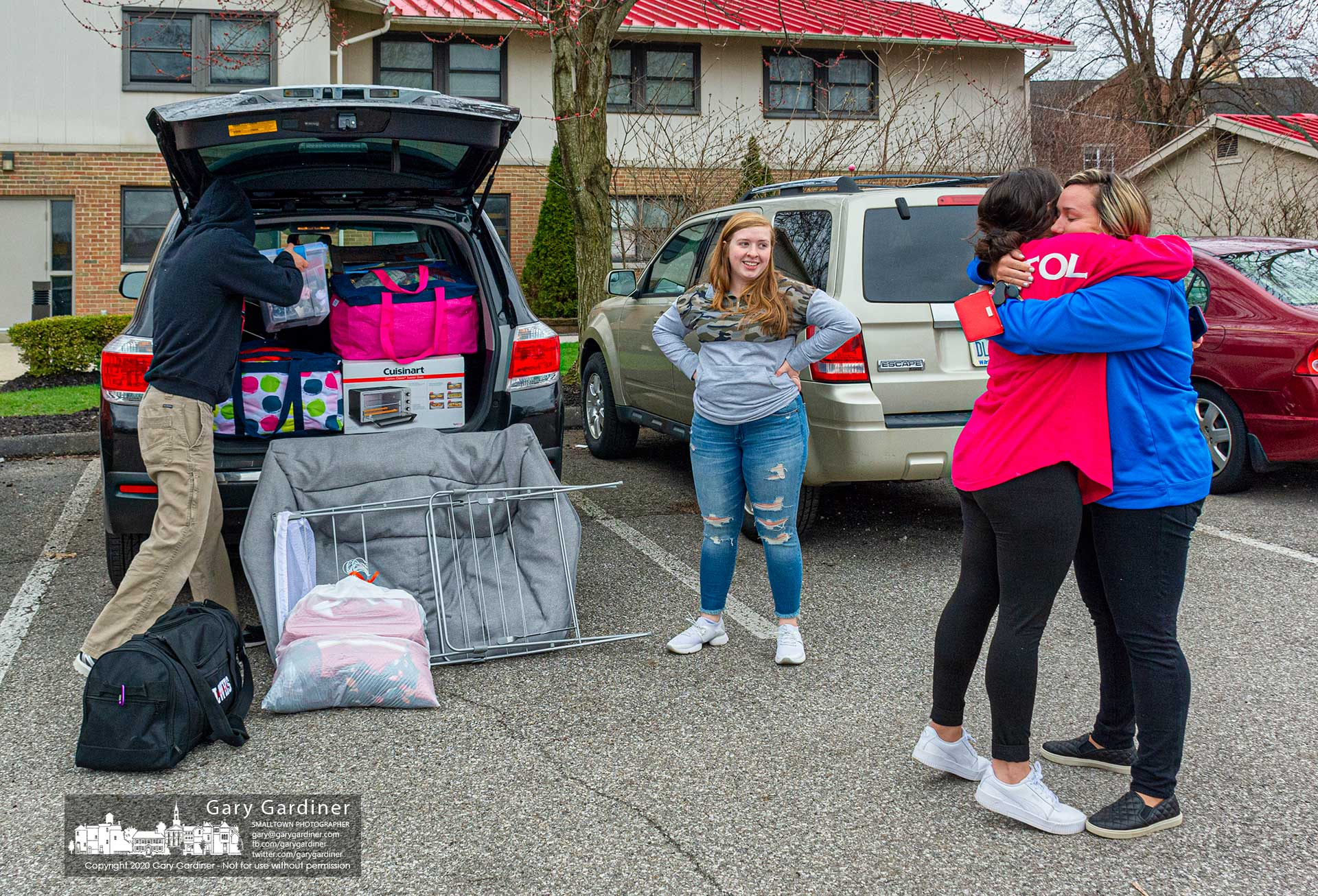 Otterbein students pack their belongings and share a hug as students in university housing must leave campus by Monday morning as part of the school's plans to limit exposure during the coronavirus pandemic. My Final Photo for March 21, 2020.